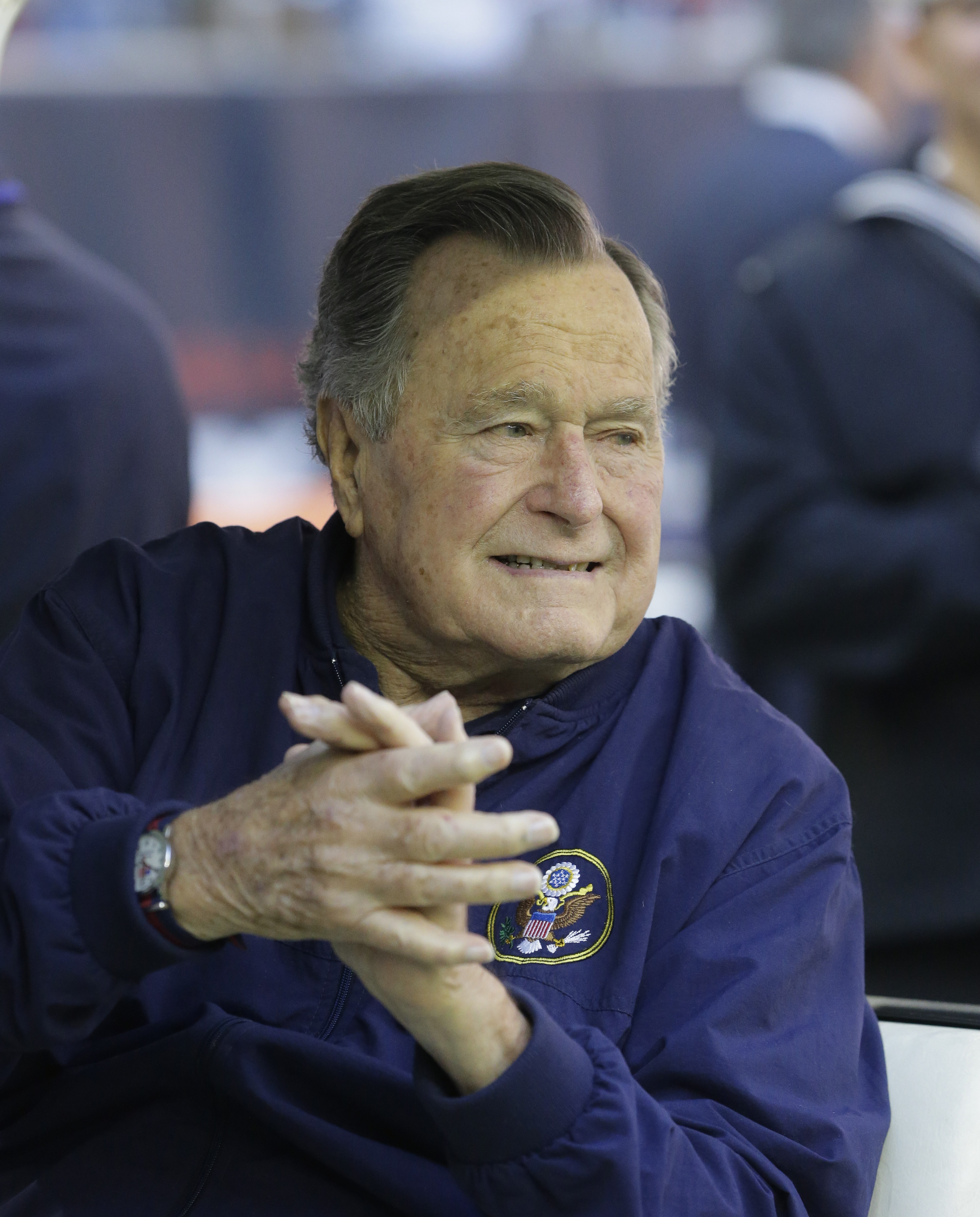 Former president George H. W. Bush attends an NFL football game between the Houston Texans an Cincinnati Bengals on Nov. 23, 2014, in Houston.