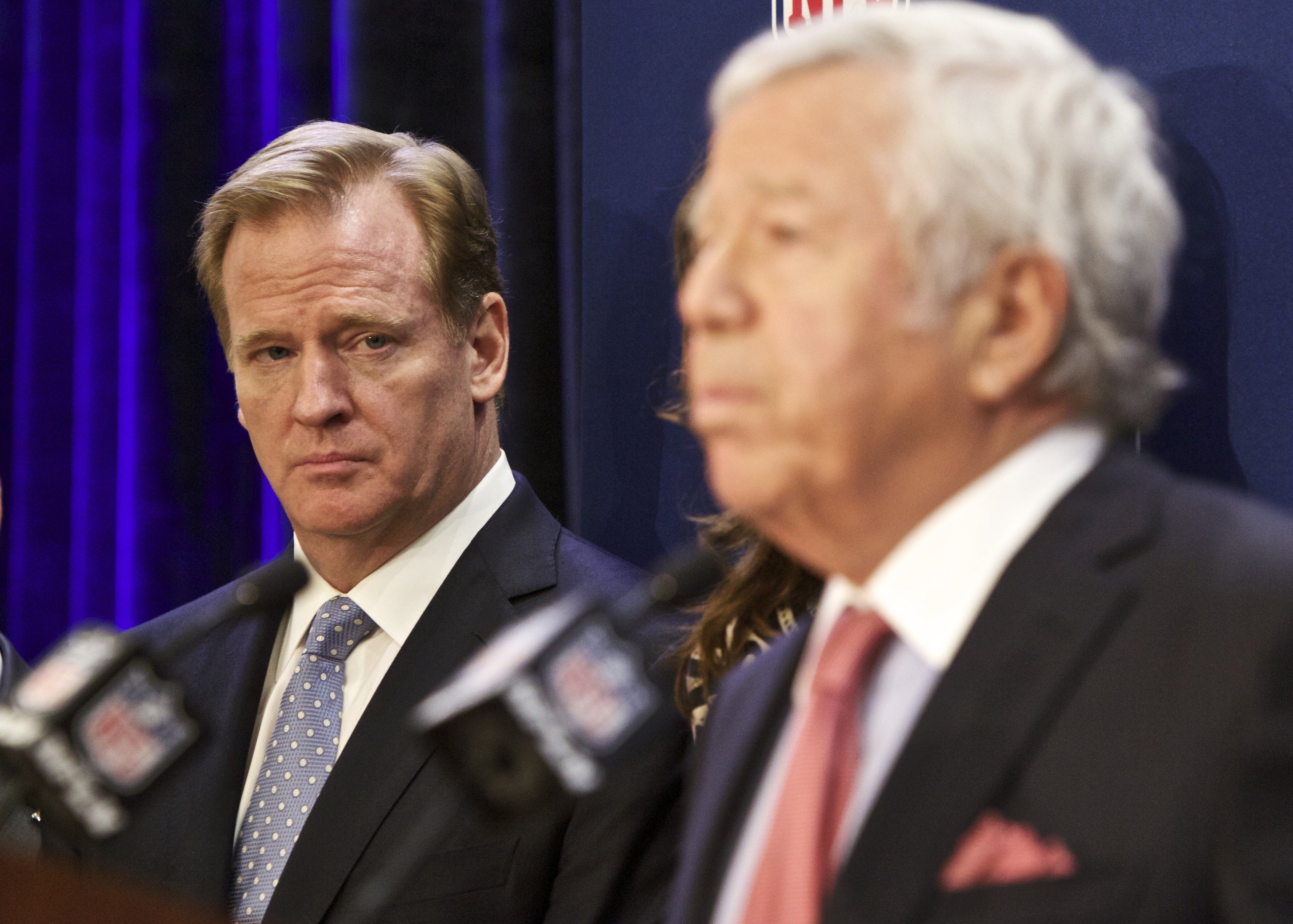 NFL commissioner Roger Goodell looks on as New England Patriots owner Robert Kraft speaks at an NFL press conference announcing new measures for the league's personal conduct policy during an owners meeting on Dec. 10, 2014, in Irving, Texas.
