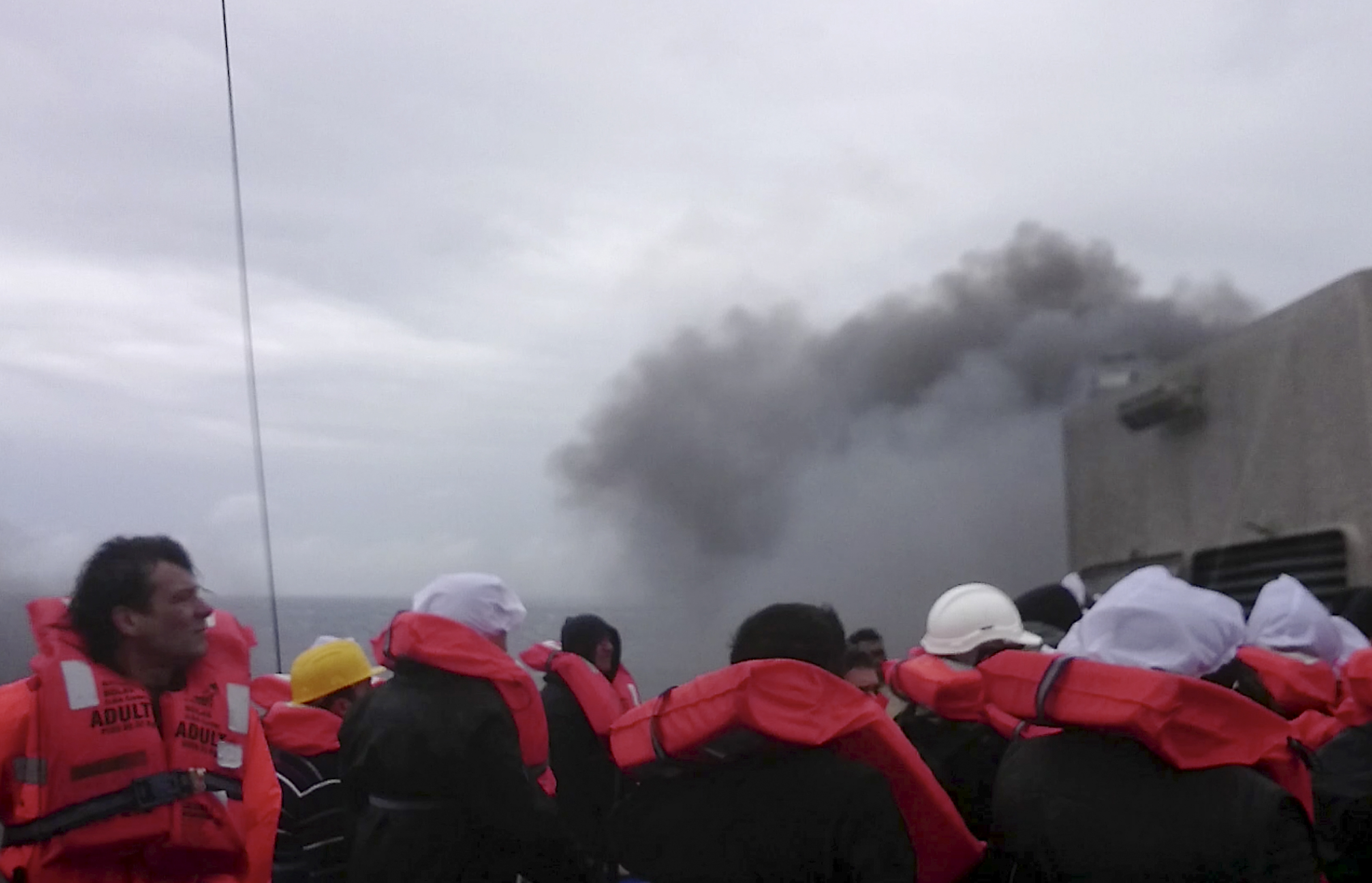 In this image taken from a Dec. 28, 2014 video and made available Wednesday, Dec. 31, 2014 passengers of the Italian-flagged ferry Norman Atlantic wait to be rescued after it caught fire in the Adriatic Sea.