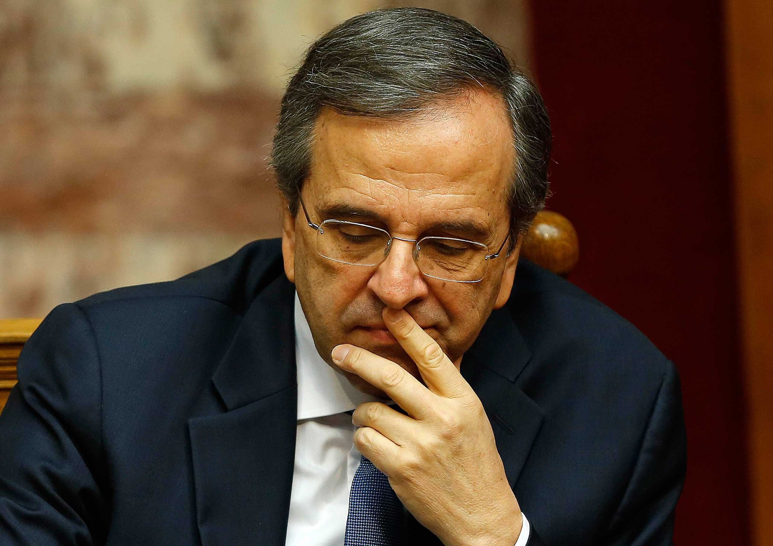 Greek Prime Minister Antonis Samaras reacts in parliament during the last round of a presidential vote in Athens on Dec. 29, 2014.