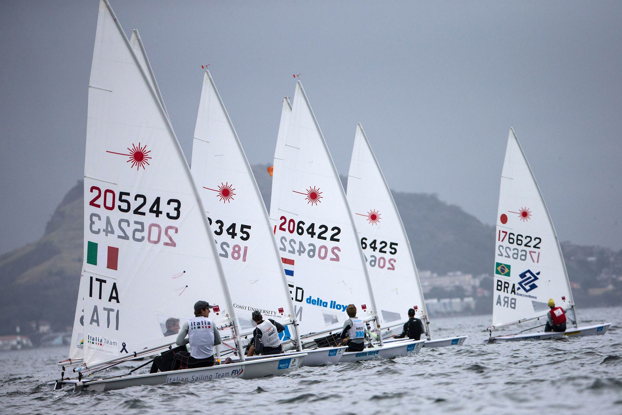 Athletes compete in the Men's Laser during the final day of Aquece Rio, the International Sailing Regatta 2014, the first test event for the Rio 2016 Olympic and Paralympic Games at Guanabara bay in Rio de Janeiro, Brazil, on August 9, 2014.