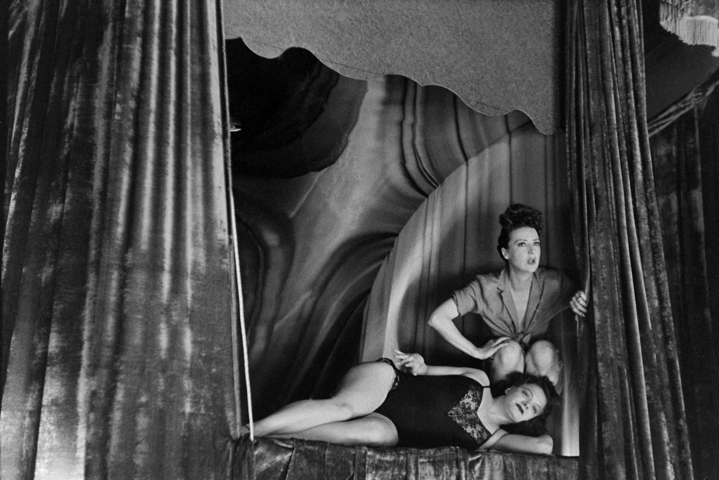 <b>Not published in LIFE.</b> Burlesque star Gypsy Rose Lee (top) with another performer in Memphis, Tenn., 1949.