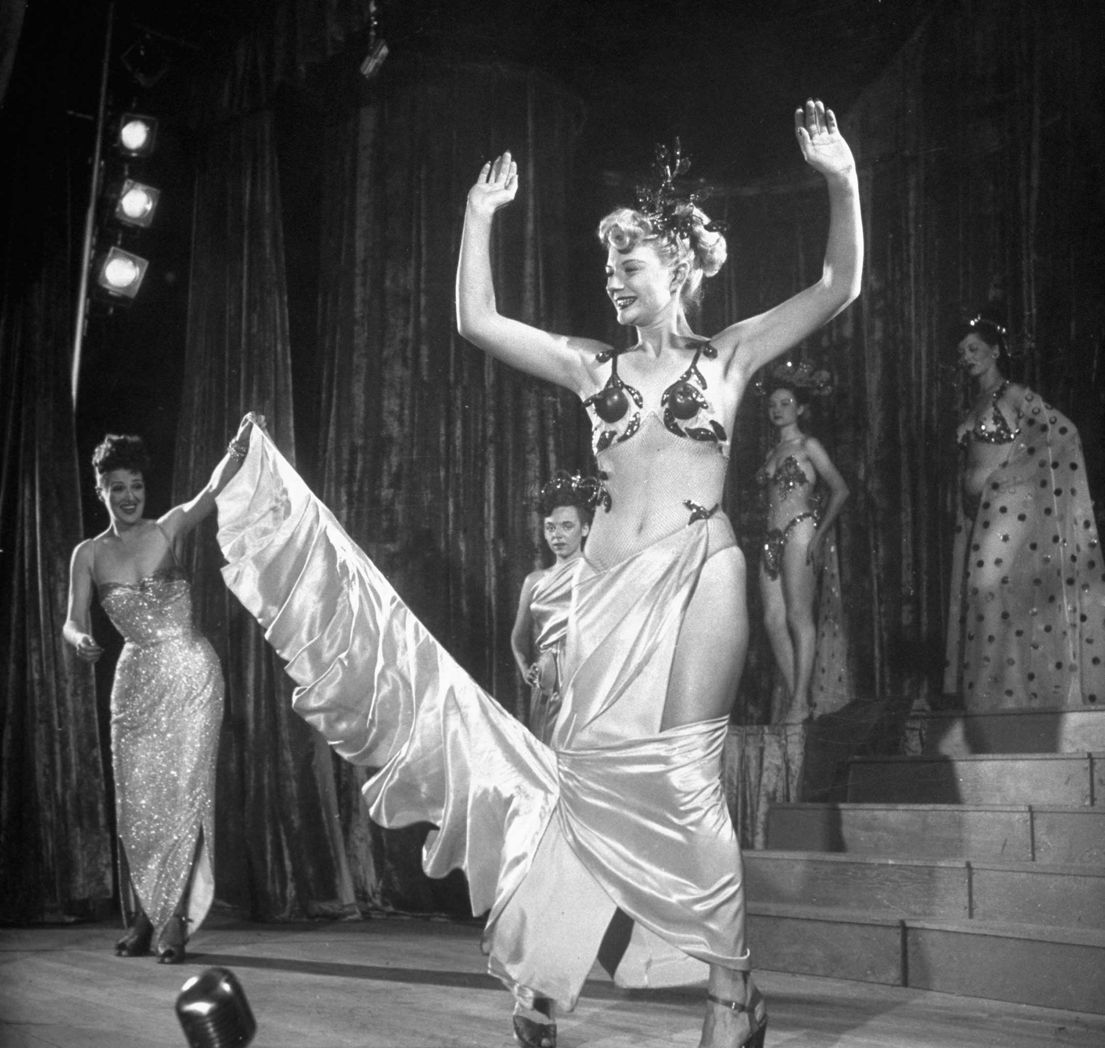 """<b>Caption from LIFE.</b> """"In a reverse strip-tease act, Gypsy introduces near-nudes like Florence Bailey, and dresses them on the stage."""