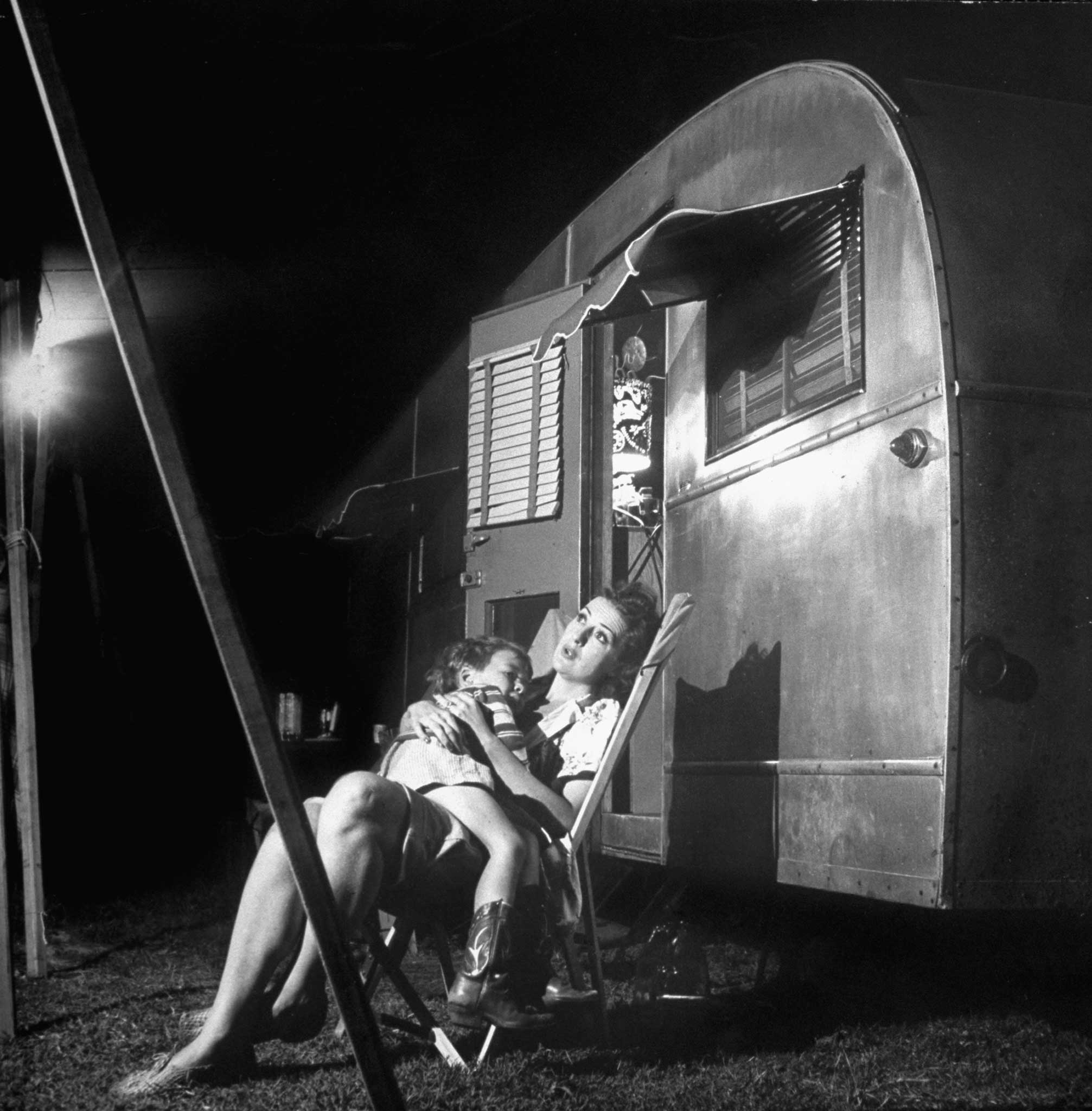 <b>Not published in LIFE.</b> Gypsy Rose Lee holds her 4-year-old son (by Otto Preminger), Erik, outside of her trailer, 1949.