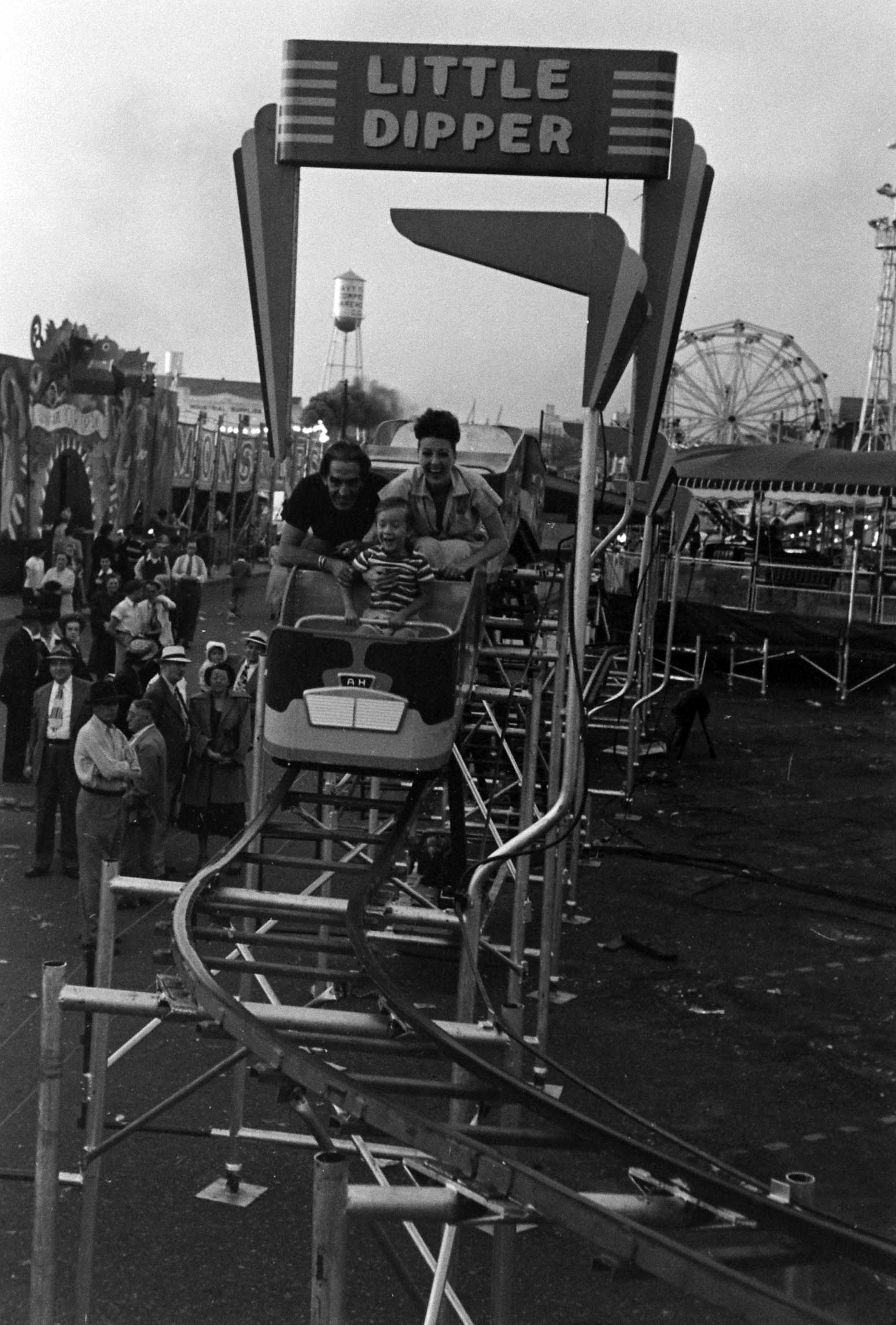 <b>Not published in LIFE.</b> Gypsy Rose rides the Little Dipper with her son, Erik, and her husband, Julio, in Memphis, Tenn., 1949.