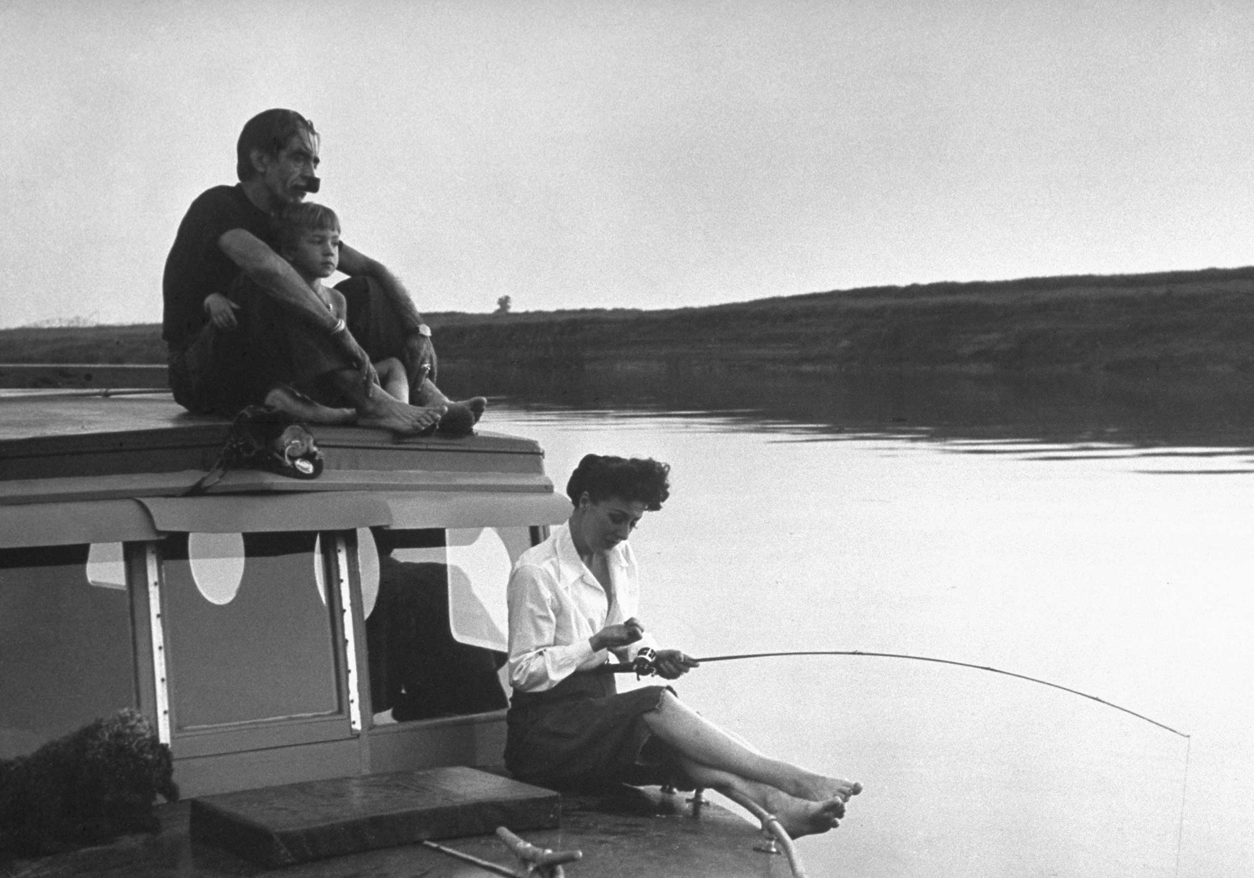 """<b>Caption from LIFE.</b> """"Between shows Gypsy and family manage to sneak off for sundown fishing on Wolf River where Gypsy caught a catfish."""""""