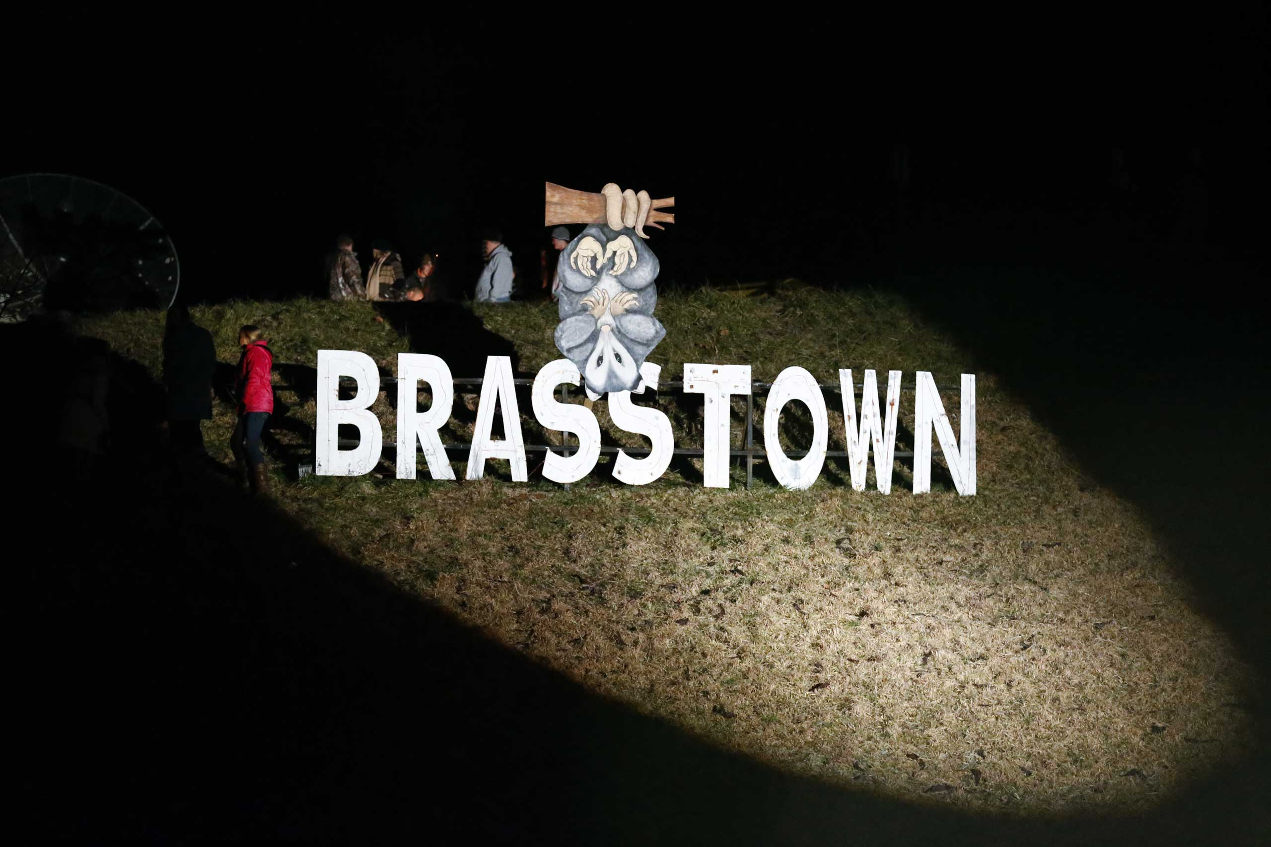 A sign honoring the possums of Brasstown is seen during the 20th annual Possum Drop on New Year's Eve at Clay's Corner in Brasstown, North Carolina, Dec. 31, 2013.