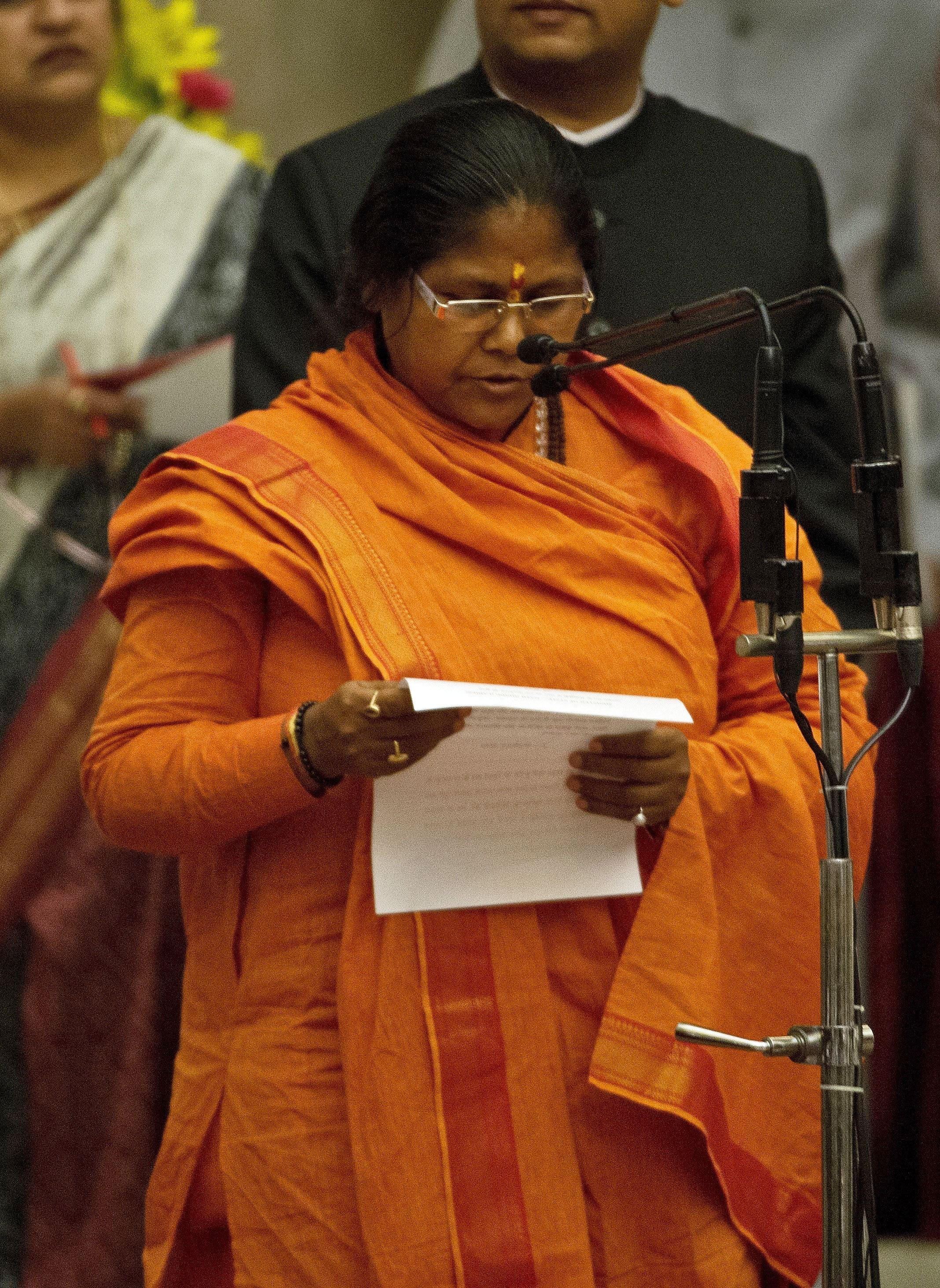 Bharatiya Janata Party leader Niranjan Jyoti takes an oath as a Cabinet minister during a swearing-in ceremony at the presidential palace in New Delhi on Nov. 9, 2014