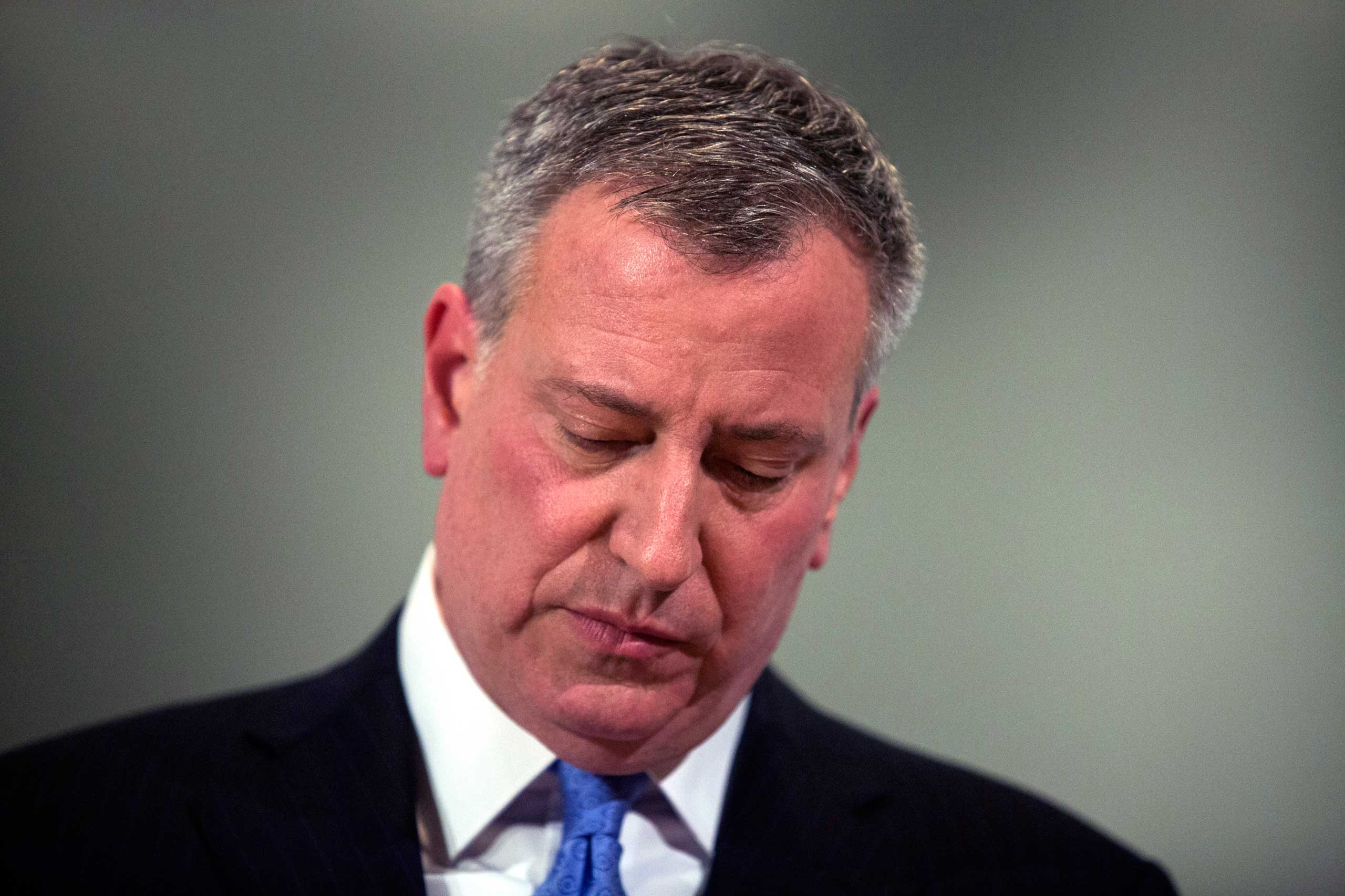 New York City Mayor Bill de Blasio speaks to the media during a news conference after two NYPD officers were shot, in Brooklyn, New York, Dec. 20, 2014.