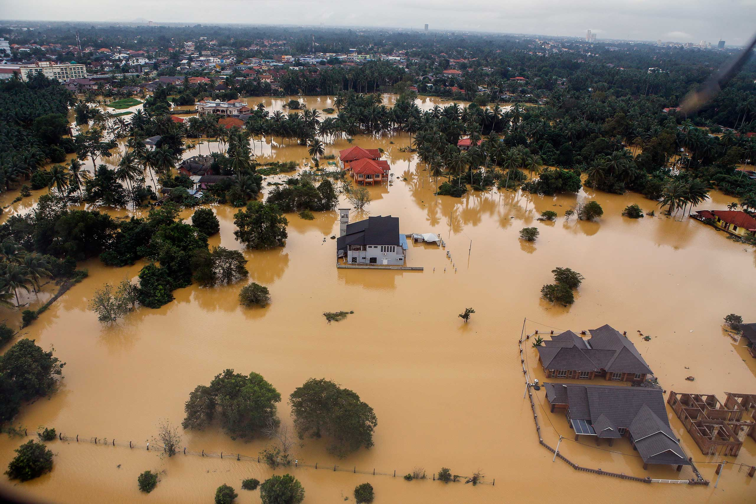 An aerial view of a settlement submerged by floodwaters in the Pengkalan Chepa district of Kelantan, Malaysia, Dec. 28, 2014.