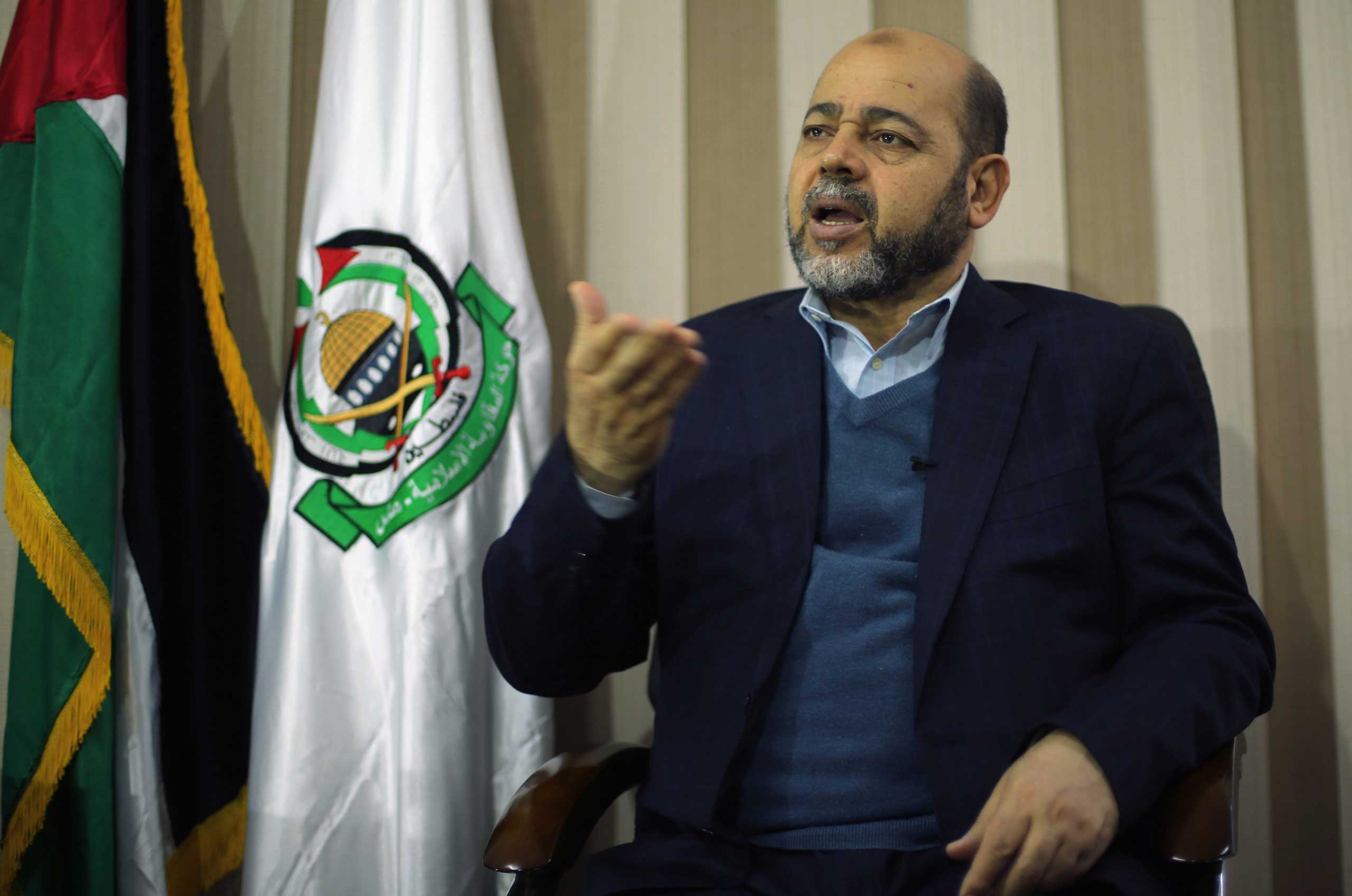 Deputy Hamas chief Moussa Abu Marzouk gestures during an interview with Reuters in Gaza City, Dec. 17, 2014.