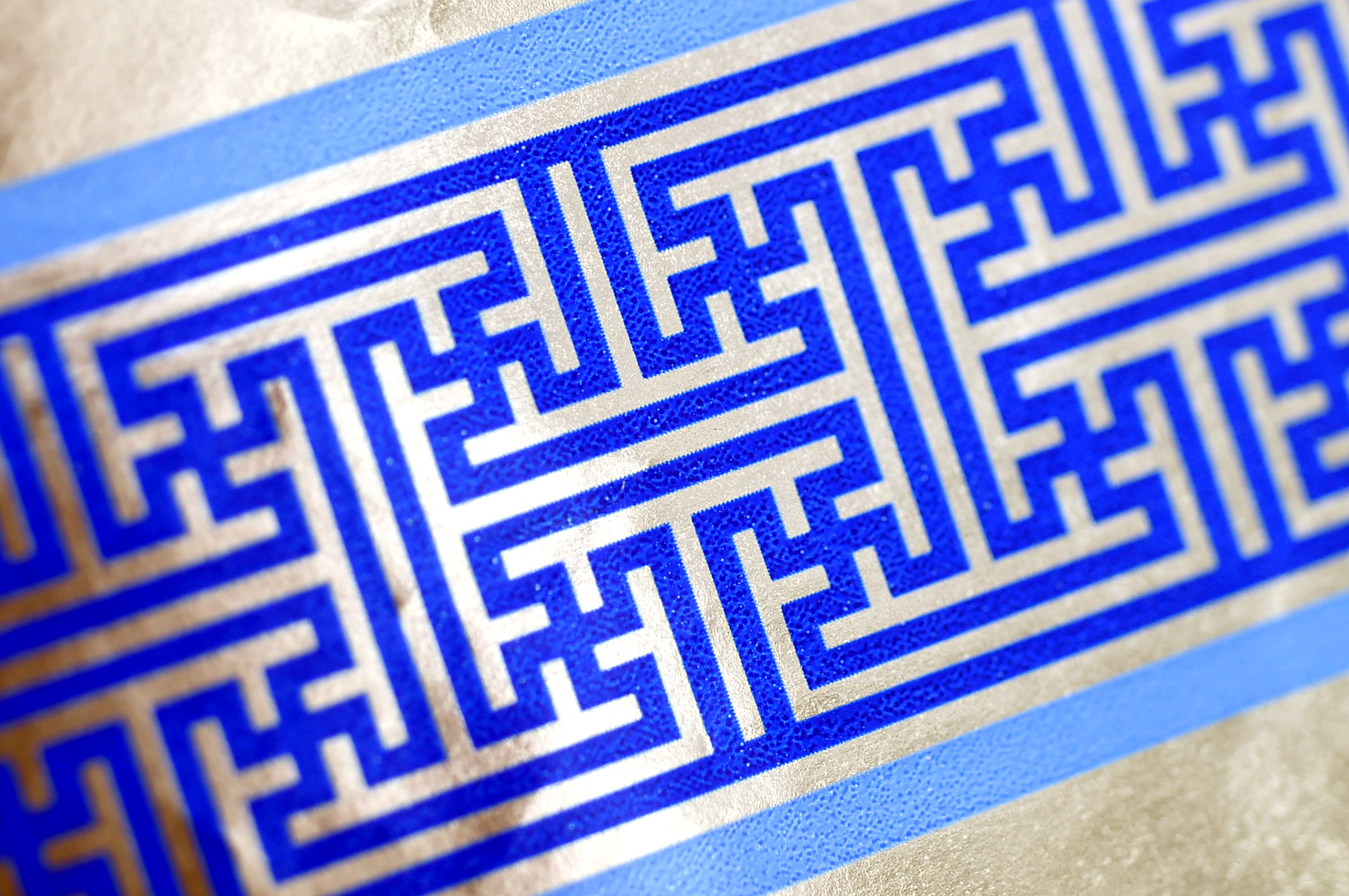 Cheryl Shapiro displays the Hanukkah gift wrap with a swastika-like pattern she found at Walgreens in Northridge, Calif., Monday,  Dec. 8, 2014