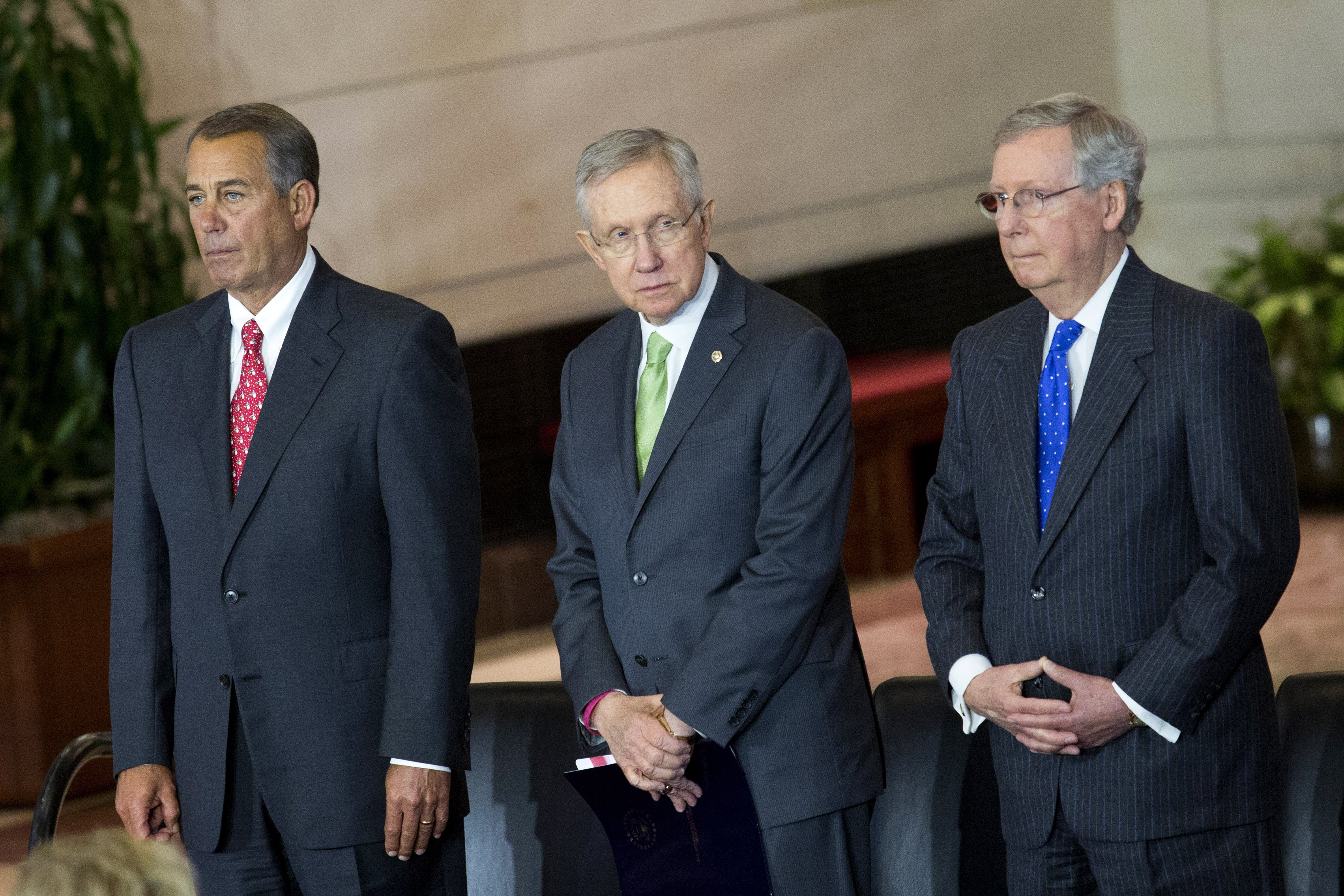 From Left: Speaker of the House John Boehner, Senate Majority Leader Harry Reid and Senate Minority Leader Mitch McConnell gather onstage prior to the start of a Congressional Gold Medal Ceremony for World War II era Civil Air Patrol members on Dec. 10, 2014 in Washington D.C.