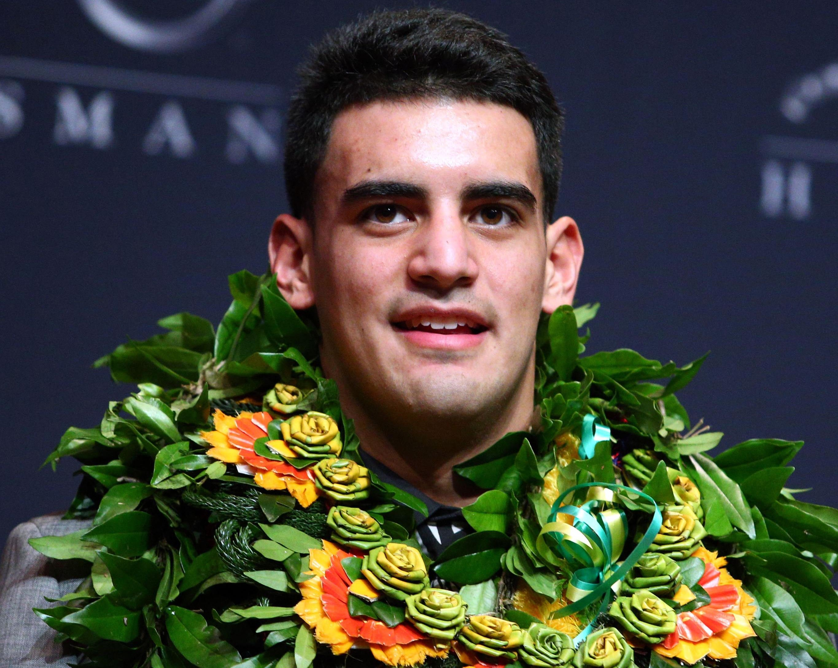 Oregon Ducks quarterback Marcus Mariota answers questions during a press conference after winning the Heisman Trophy in New York on Dec. 13, 2014.