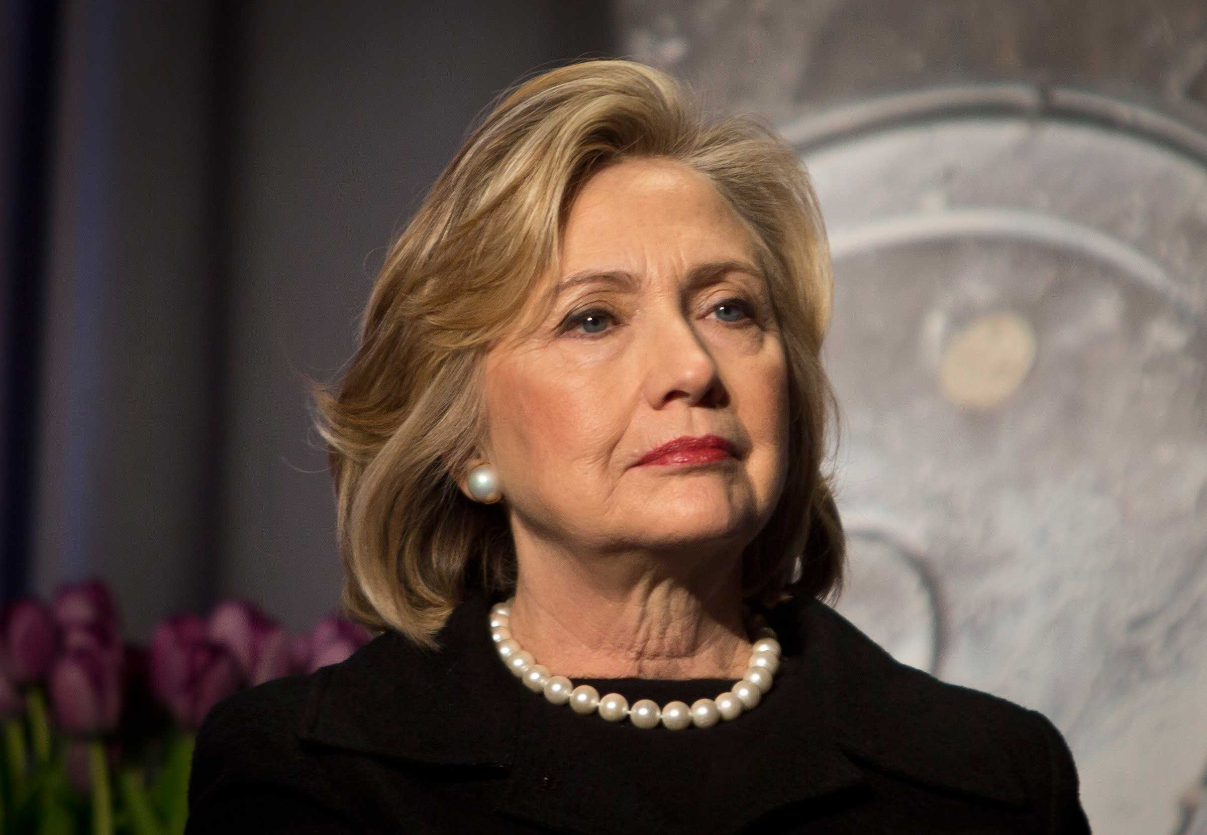 Hillary Rodham Clinton listens before delivering remarks at an event in New York City on Nov. 21, 2014.