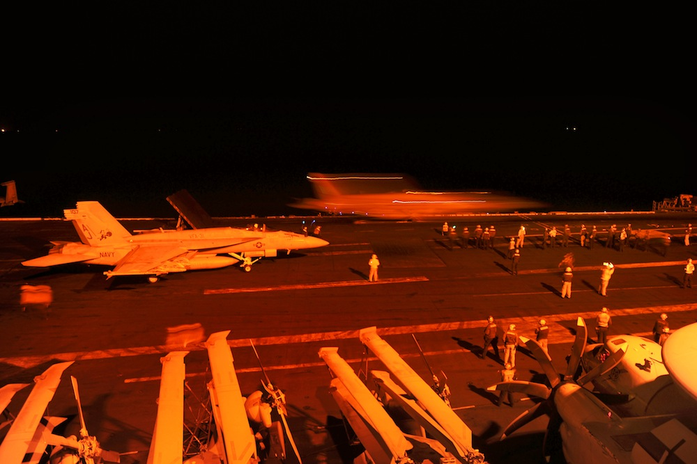 U.S. Navy warplanes prepare to attack ISIS targets.