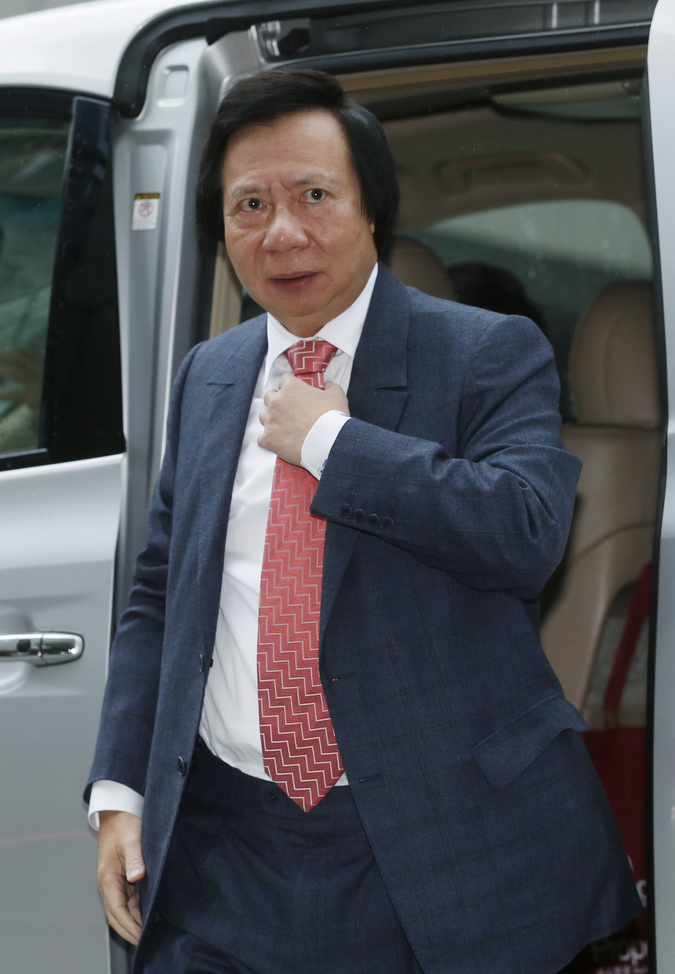 Thomas Kwok, co-chairman of Hong Kong developer Sun Hung Kai Properties, arrives at the High Court in Hong Kong on Dec. 19, 2014