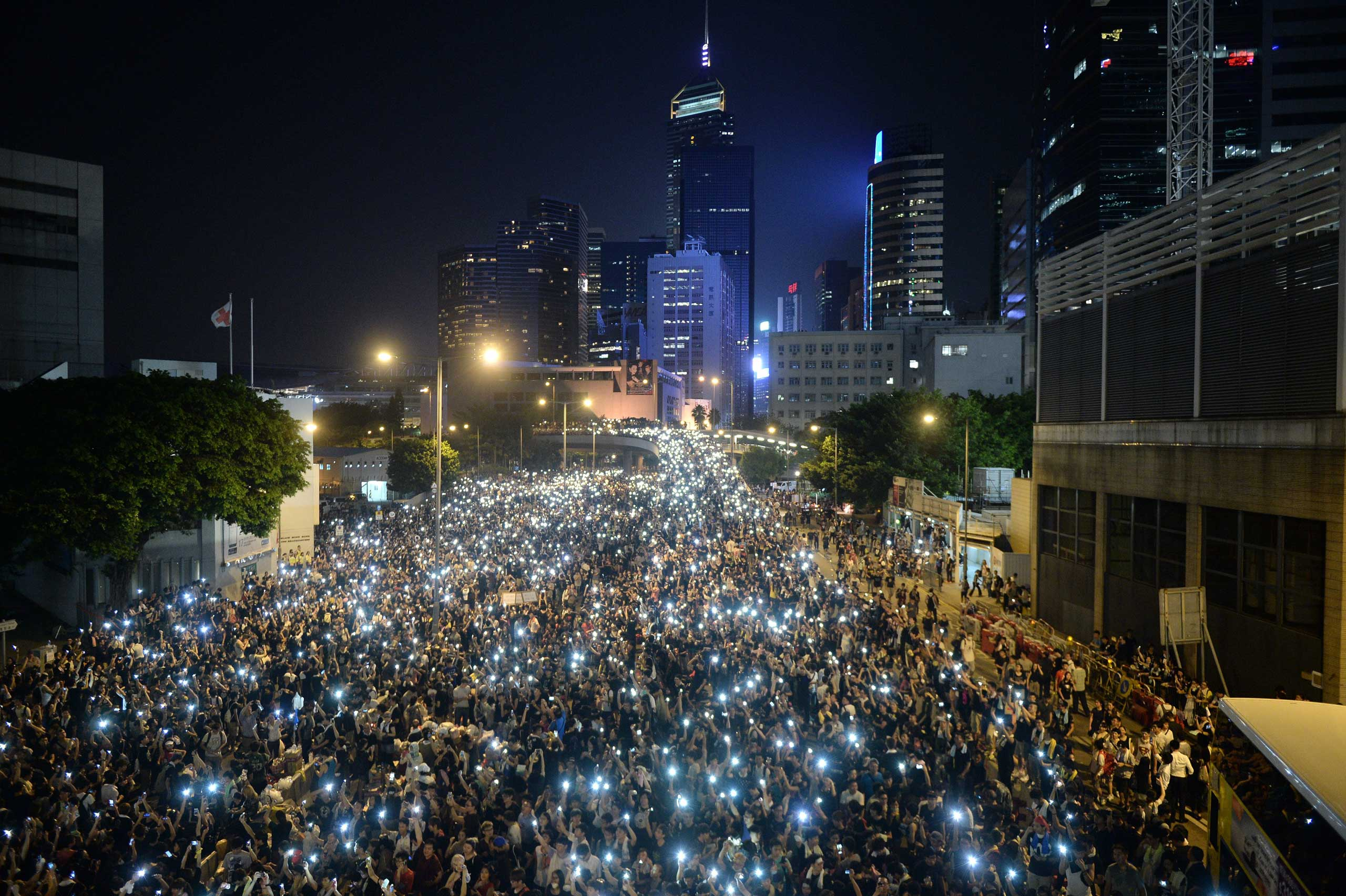 China: Pro-democracy demonstrations in Hong Kong Protesters hold up their mobile phones during a protest near the Hong Kong government headquarters on Sept. 29, 2014.
