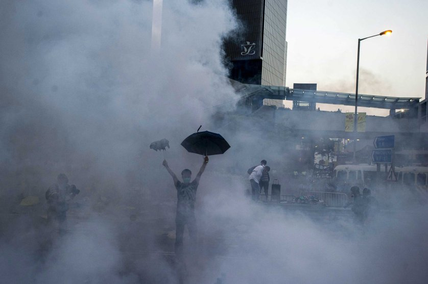 A pro-democracy demonstrator gestures after police fired tear gas towards protesters near the Hong Kong government headquarters on Sept. 28, 2014.