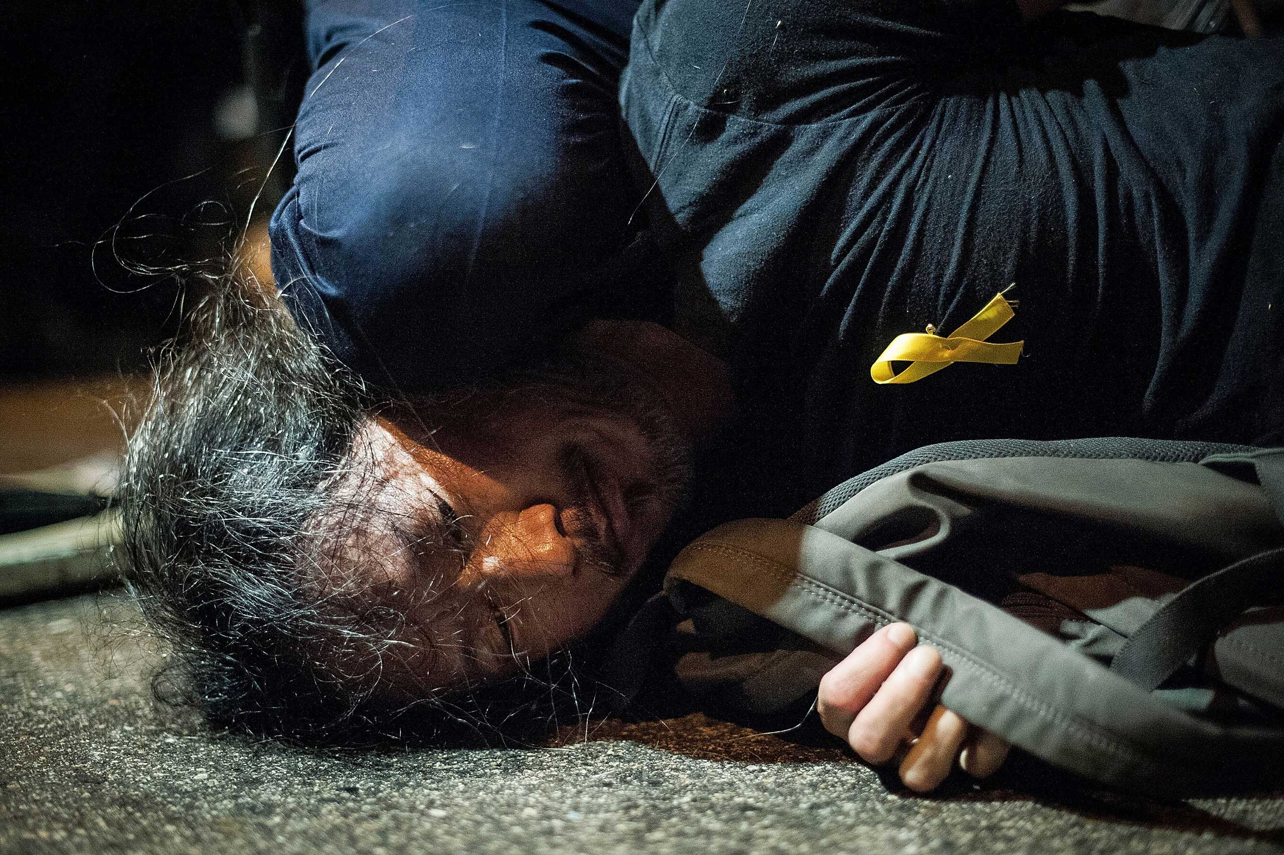 Police arrest a pro-democracy protester on Lung Wo Road outside Hong Kong's Government complex on Nov. 30, 2014 in Hong Kong.