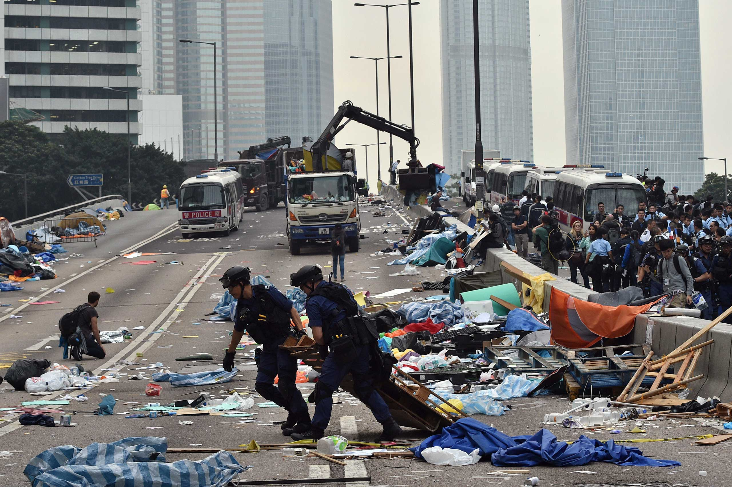 Hong Kong police dismantle the remains of the pro-democracy protest camp in the Admiralty district of Hong Kong on Dec. 11, 2014.