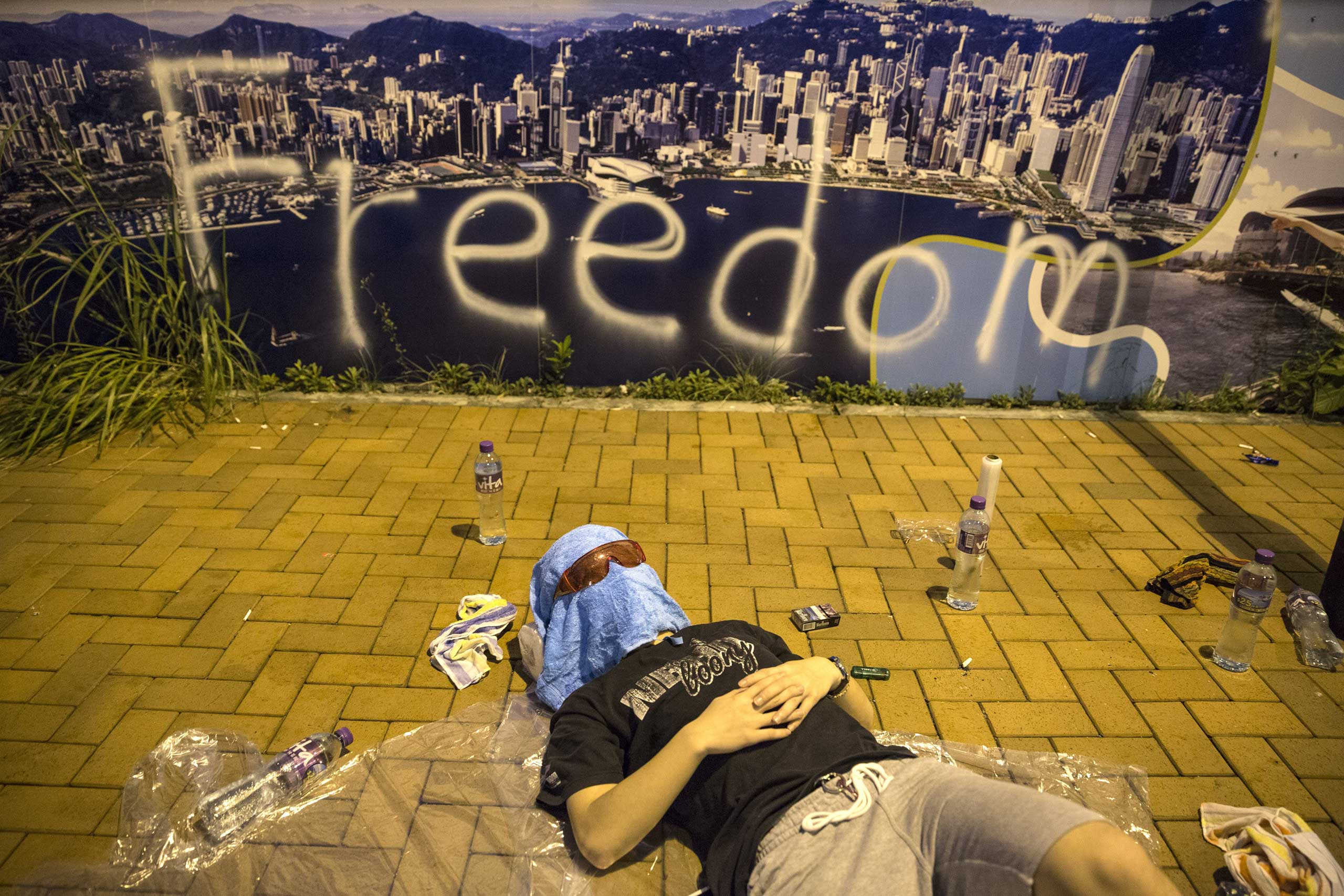A protester sleeps on the streets outside the Hong Kong Government Complex at sunrise on Sept. 30, 2014 in Hong Kong.