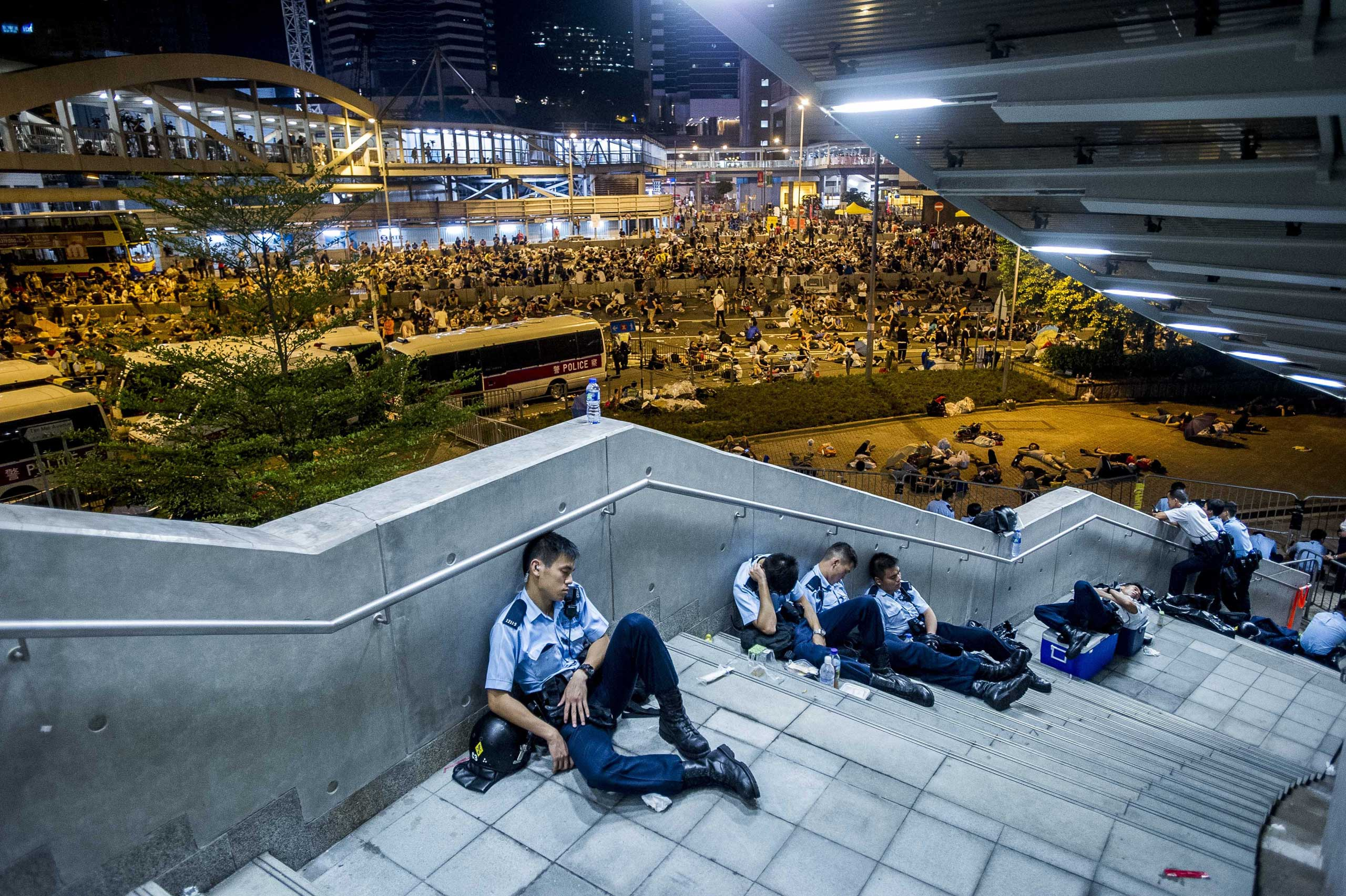 Policemen rest following pro-democracy protests in Hong Kong on Sept. 29, 2014.