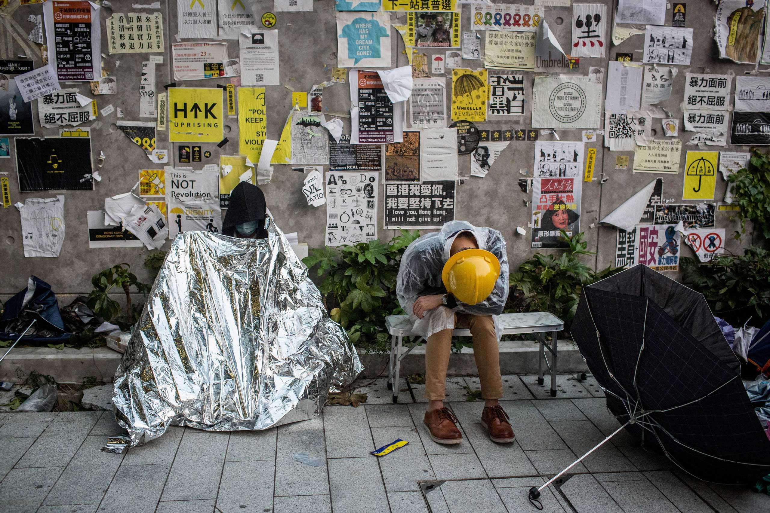 Pro-democracy activists sleep outside the Legislative Council building after protesters clashed with police on Nov. 19, 2014 in Hong Kong.
