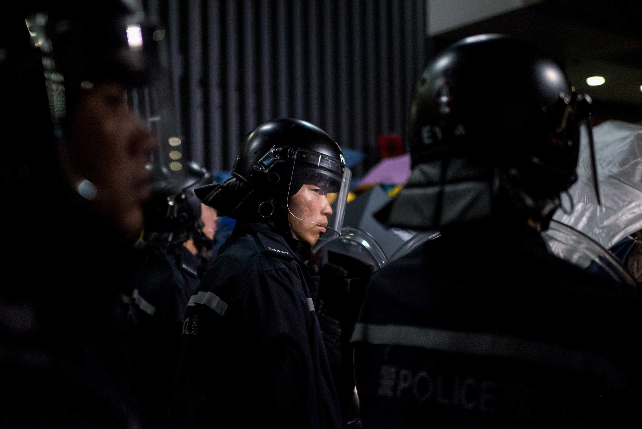 Police face pro-democracy protesters on Nov. 19, 2014 outside the central government offices in the Admiralty district of Hong Kong.