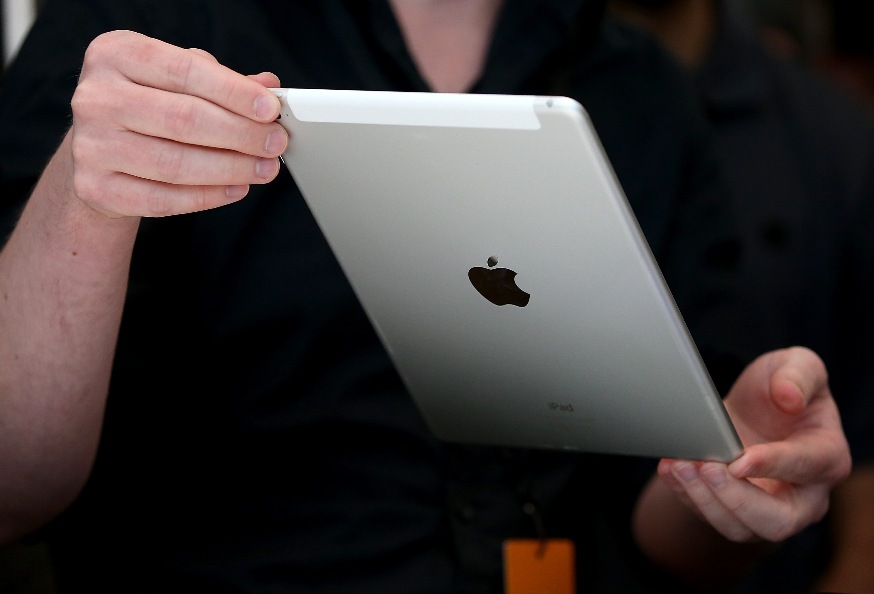 An attendee inspects new iPad Air 2 during an Apple special event on Oct. 16, 2014 in Cupertino, Calif.