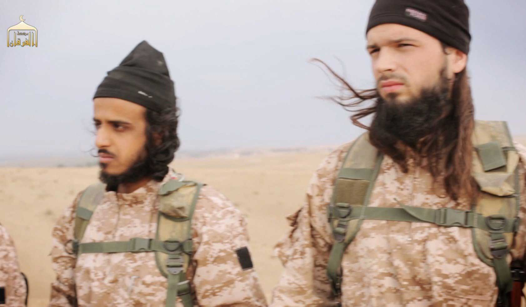 A frame grab from a propaganda video released on Nov. 16, 2014 shows members of The Islamic State in Iraq and Syria, with among them French citizen Maxime Hauchard, before taking part in the beheadings of Syrian soldiers.