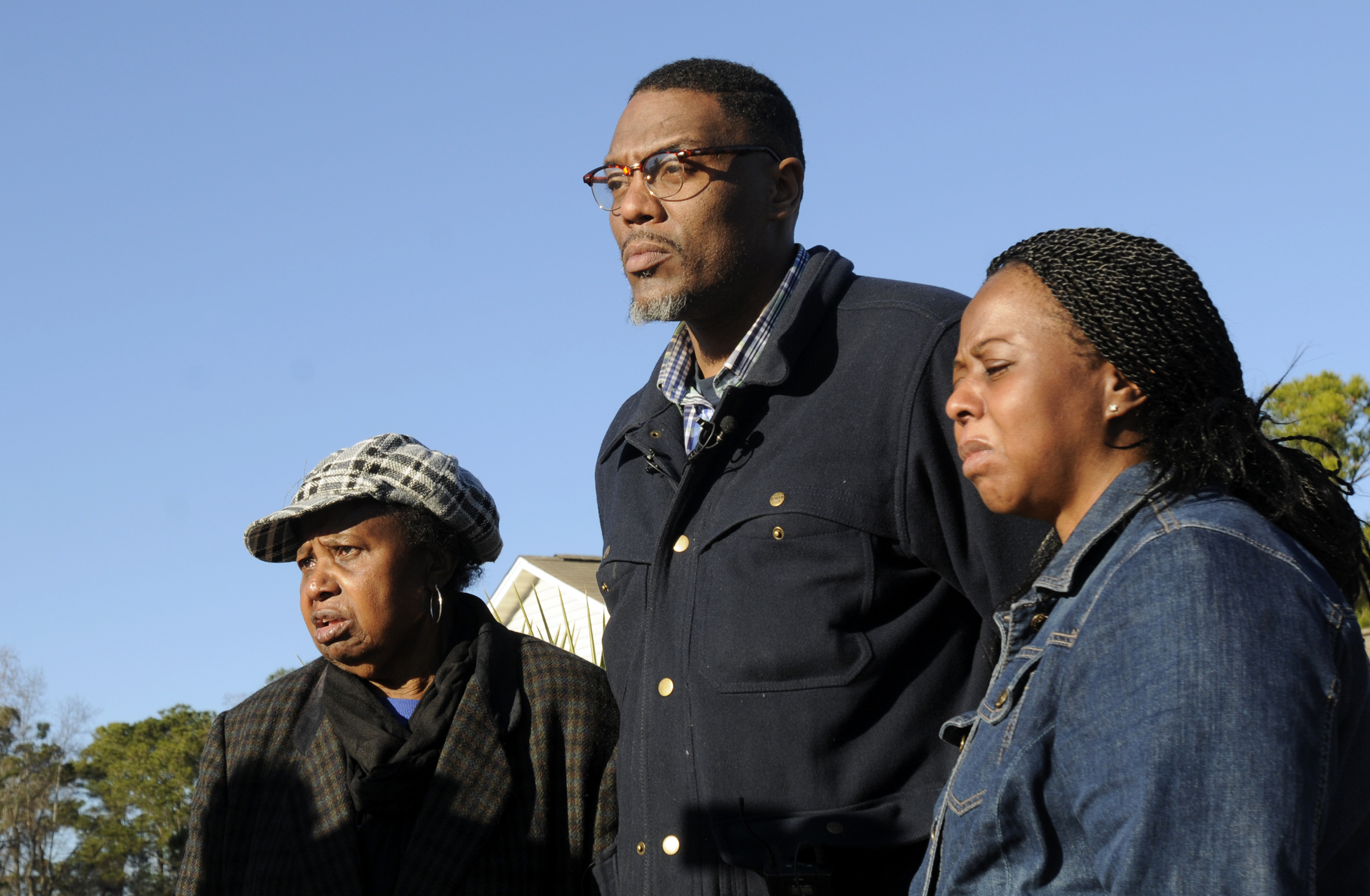 The family of missing Jayden Morrison, from left, his grandmother, Carolyn Sumpter, father, Andre Morrison and mother Tabatha Morrison look on during search efforts in Little River, S.C., on Dec. 25, 2014.