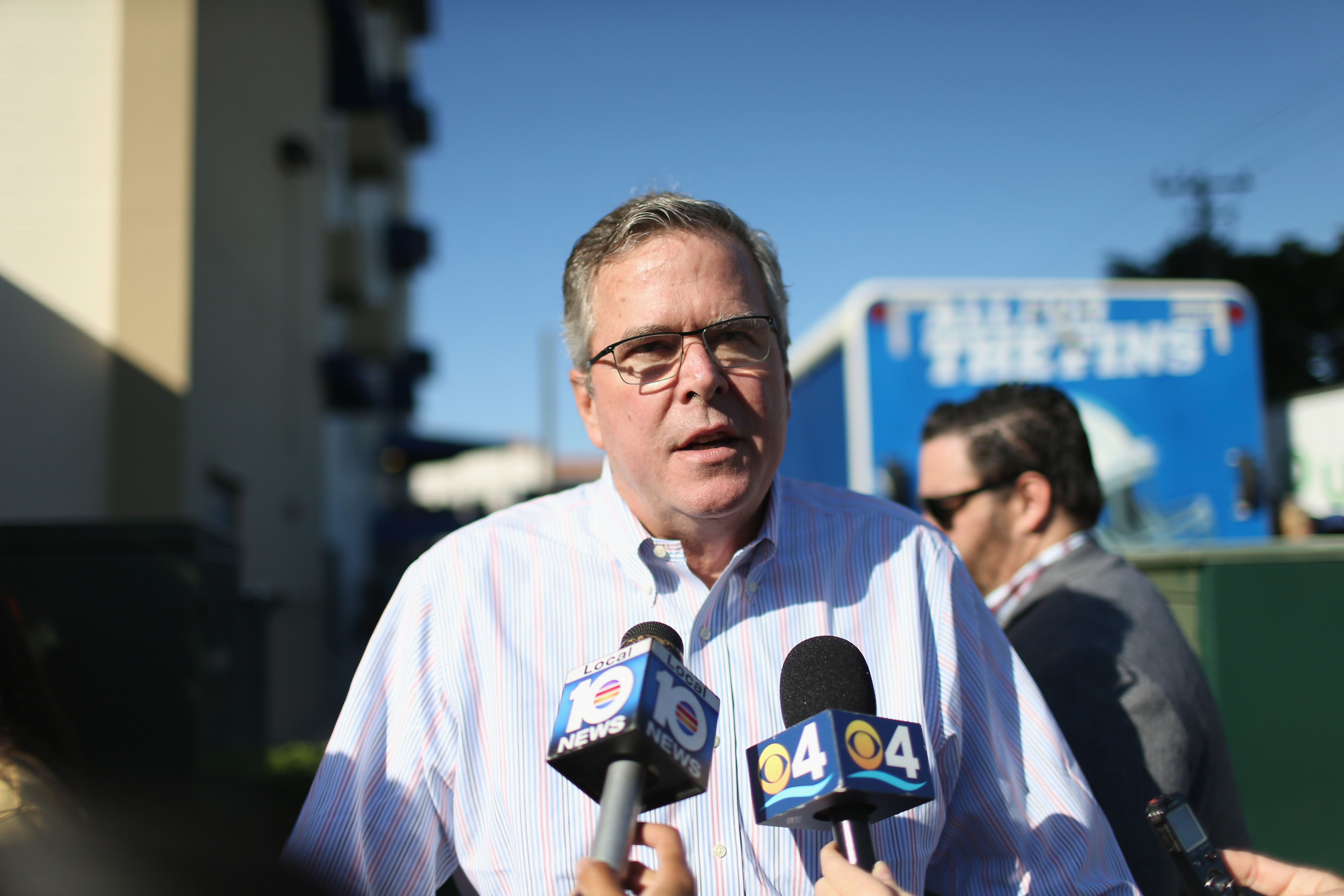 Jeb Bush speaks to the media while handing out holiday food baskets in Miami on Dec.  17, 2014.