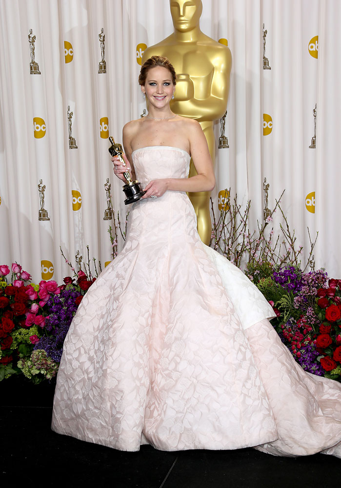 """Jennifer Lawrence lived up to her name as """"The Girl On Fire"""" with a spectacular 2013. She started off the year on a high note winning the Best Actress Oscar for her role in Silver Linings Playbook."""