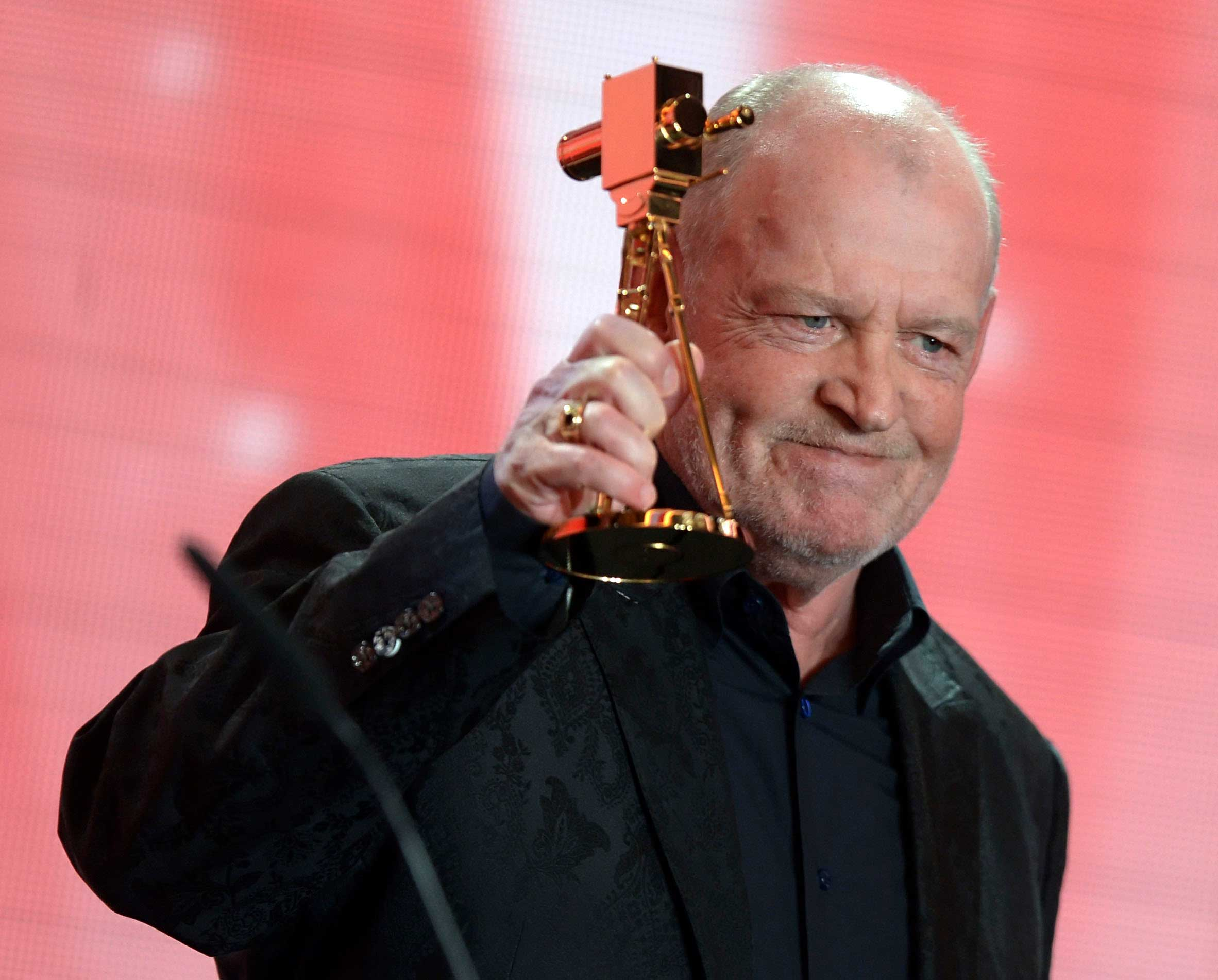 Joe Cocker speaks after receiving the trophy for Category 'lifetime achievement award music' during the 48th Golden Camera award ceremony in Berlin, Feb. 2, 2013.