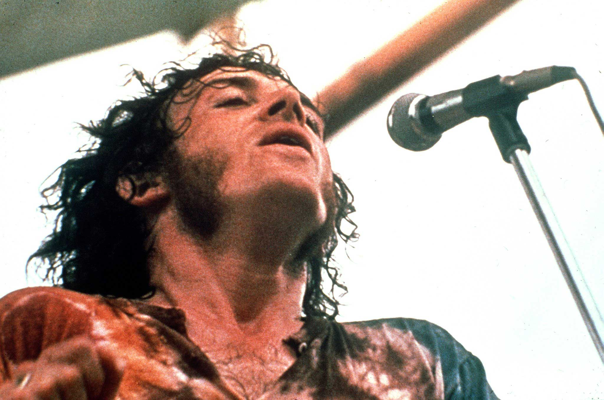 Joe Cocker performs at the Woodstock Festival of Arts and Music in Bethel, New York, Aug. 1969.