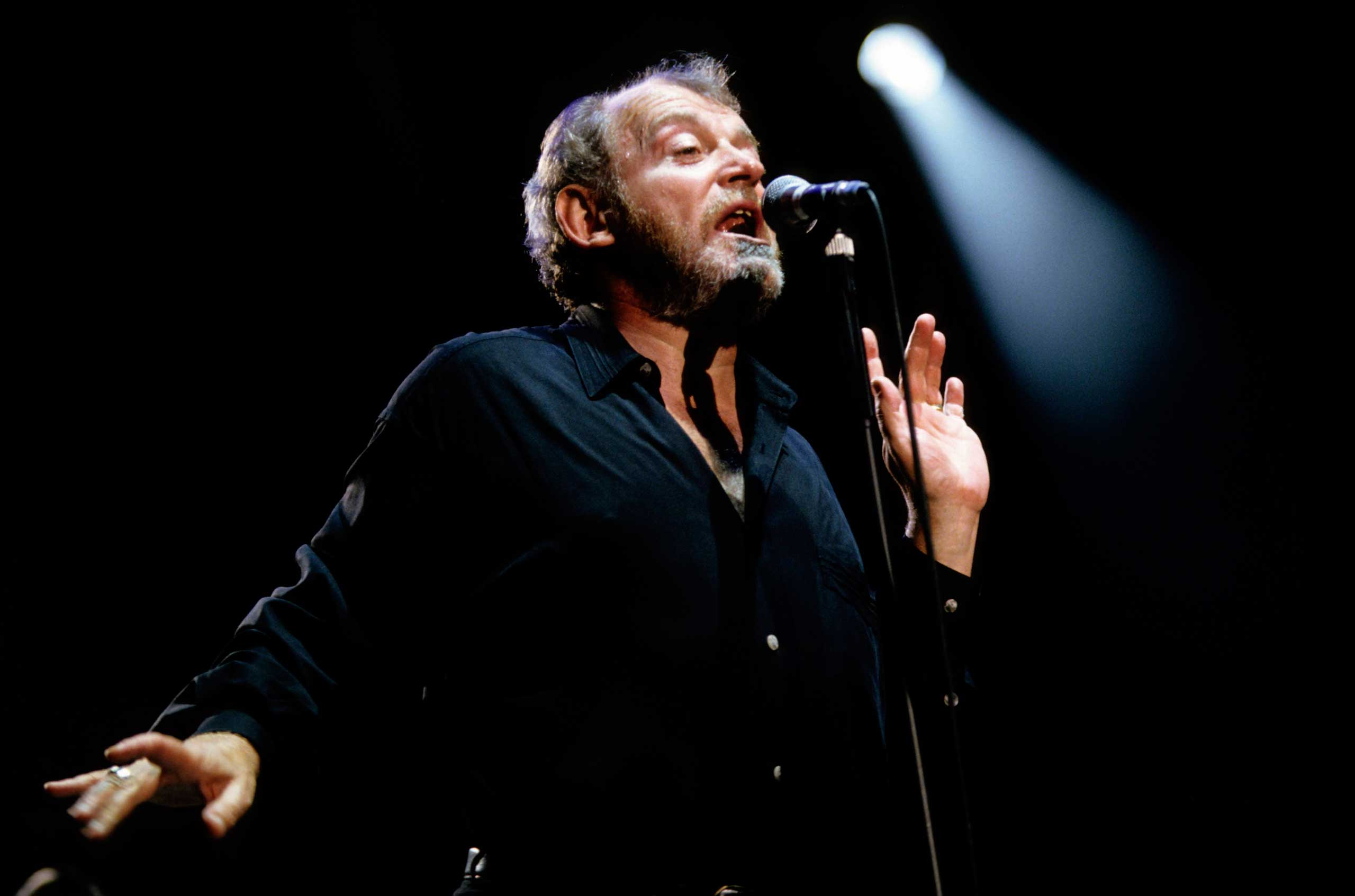 Joe Cocker performs in the UK in 1990.