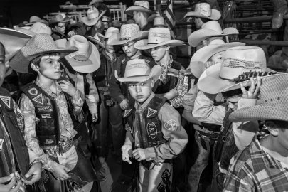 August 2, 2014: Finalist mutton busters and calf riders wait in the arena alley before the invocation and their introduction on the final day of competition.