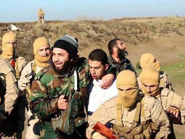 A still image released by the Islamic State on Dec. 24, 2014 purportedly shows a Jordanian pilot captured by ISIS fighters after they shot down a warplane from the US-led coalition with an anti-aircraft missile near Raqqa city.