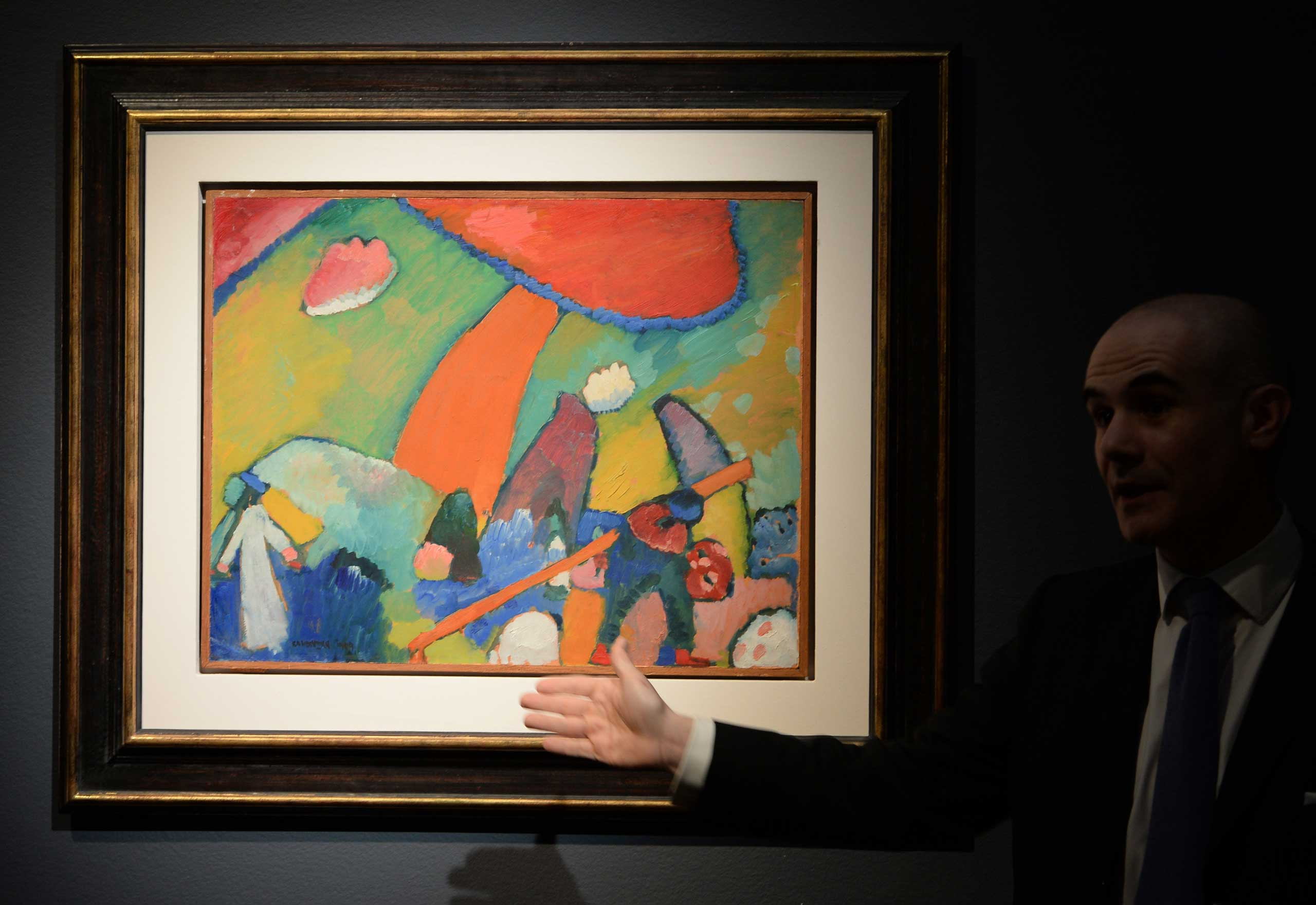 The Department Chairman of Impressionist and Modern Art at Christie's, speaks about Wassily Kandinsky's  Strandszene , painted in 1909, on display May 2, 2014 in New York City.