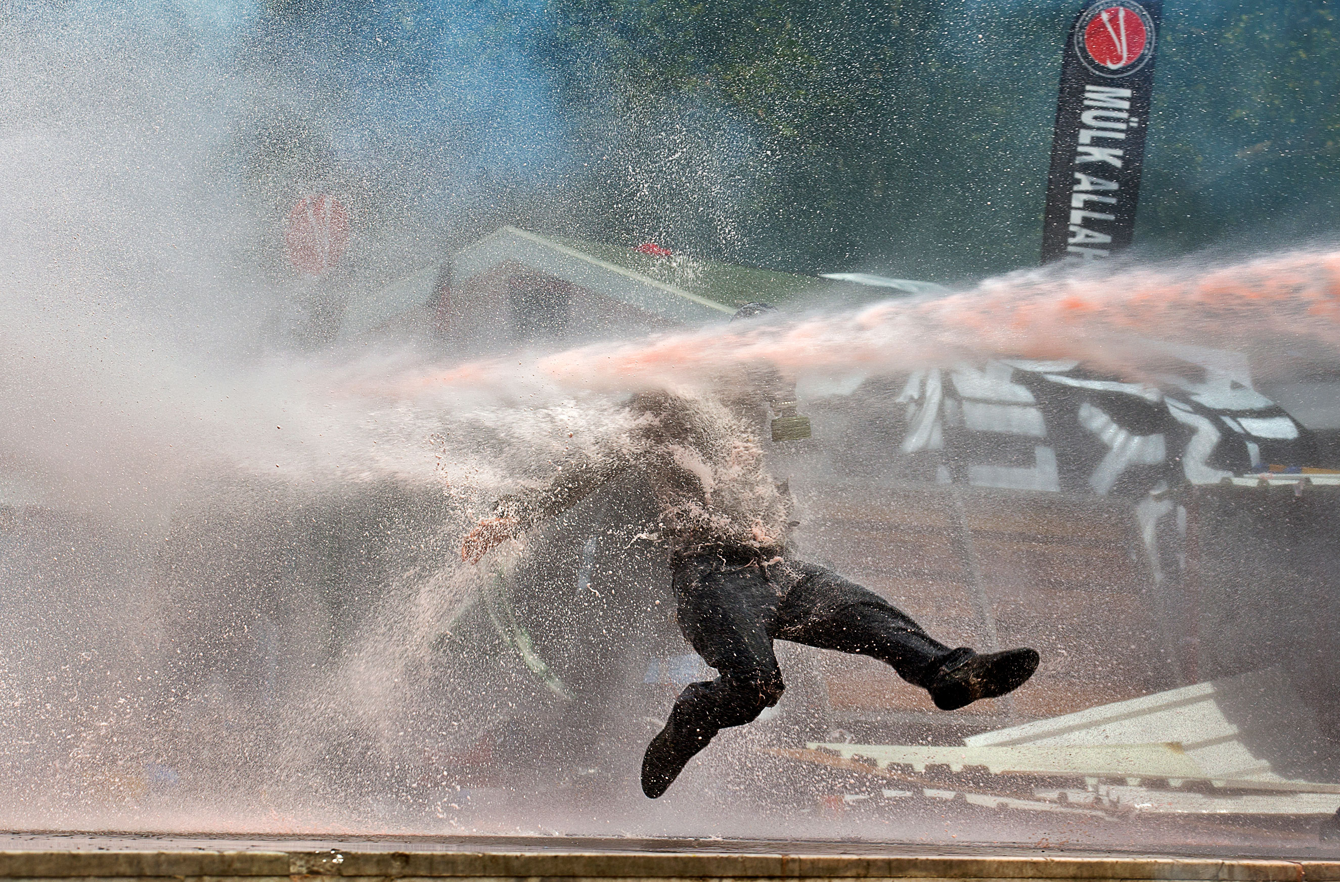A protester is hit by a water cannon during clashes in Taksim Square in Istanbul on June 11, 2013.