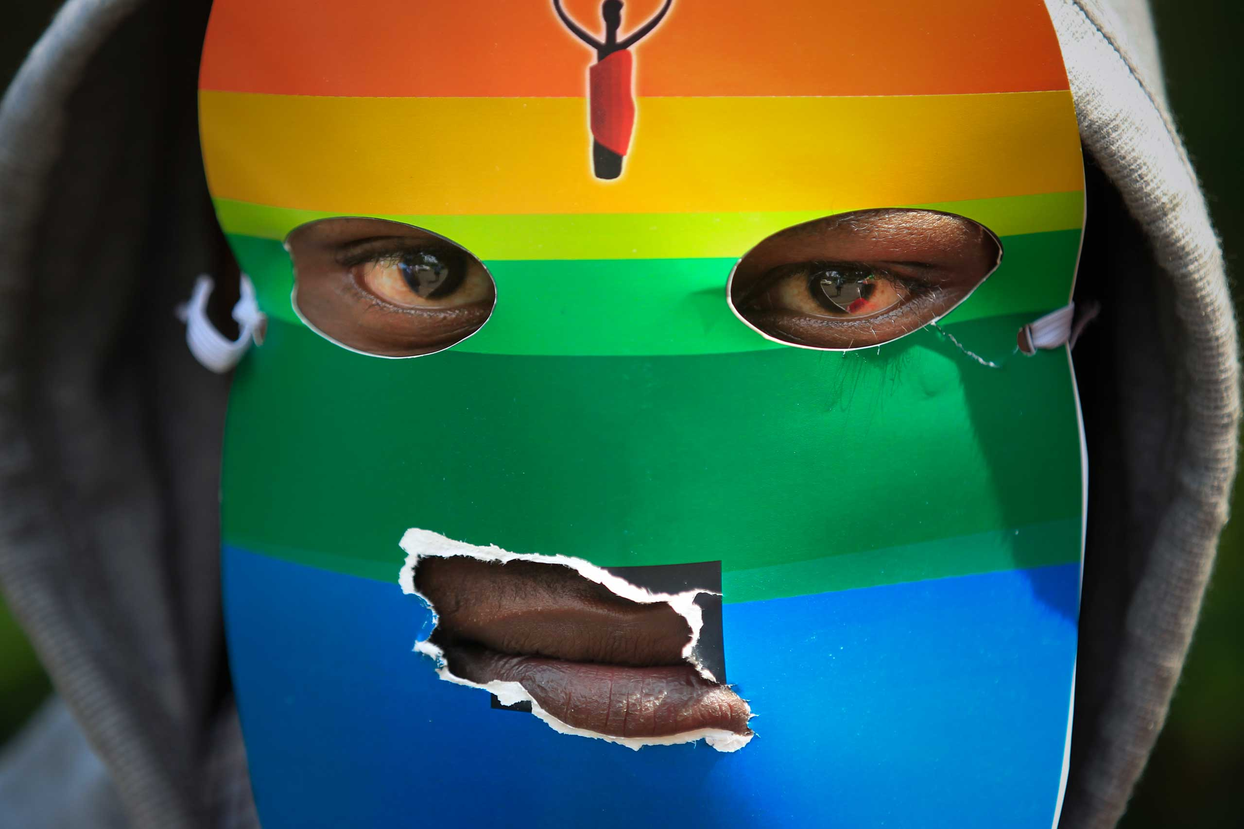 Kenya: Support for LGBT rightsA masked Kenyan supporter of the LGBT community joins others during a protest against Uganda's anti-gay bill in front of the Ugandan High Commission in Nairobi, Kenya, Feb. 10, 2014.