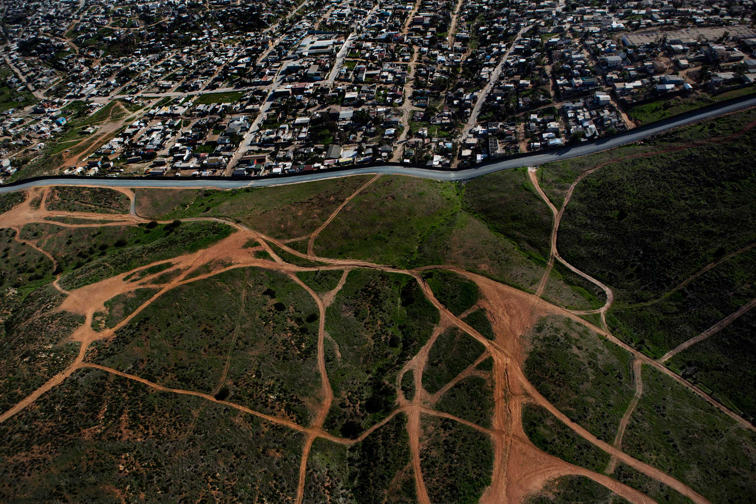 An aerial of jeep trails in the United States (bottom), in an area that was once a popular crossing point into the United States from Tijuana, Mexico (top), Feb. 15, 2013.