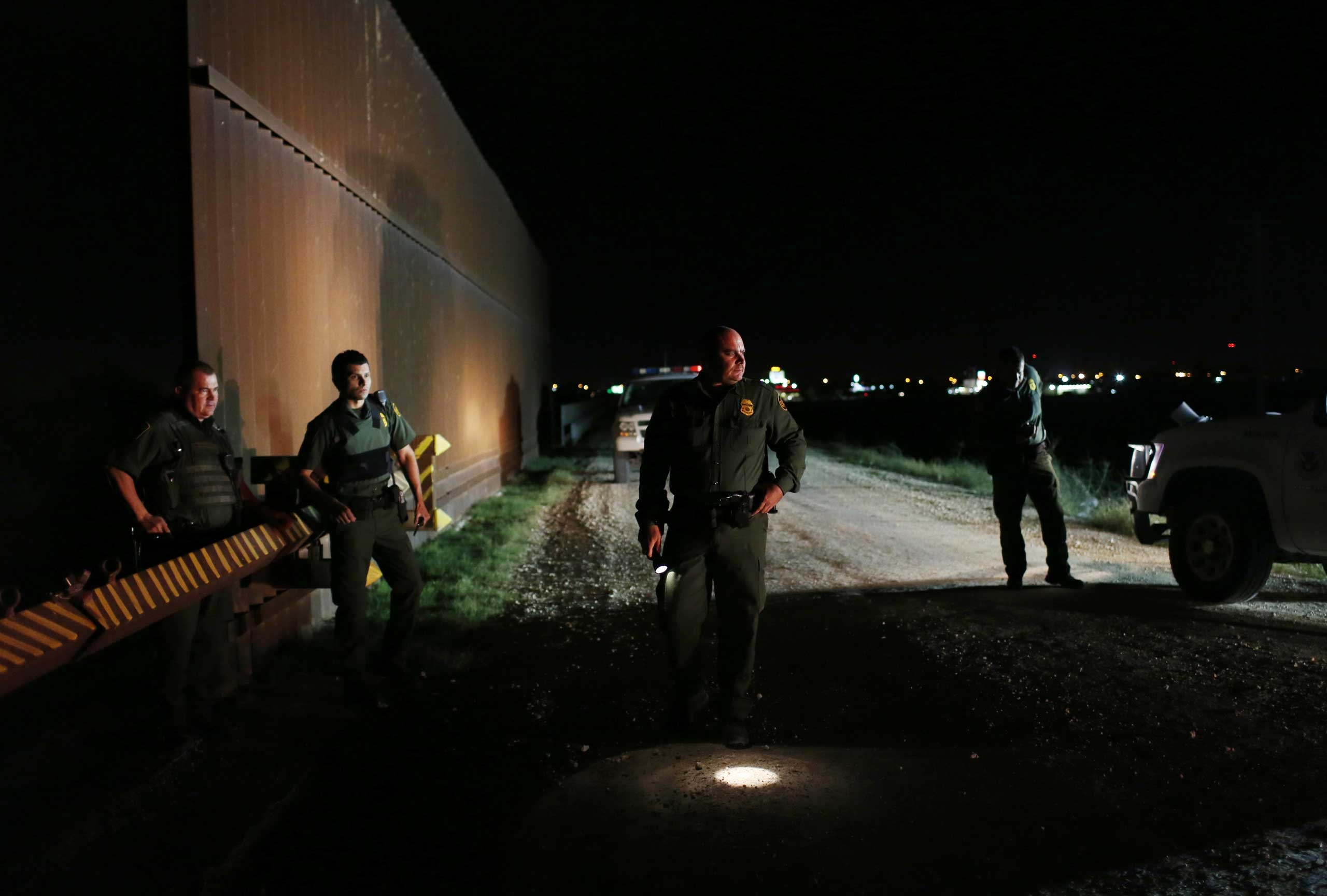 Border Patrol Agents respond to a call near a section of the border fence in Hidalgo, Texas on Feb. 13, 2013.