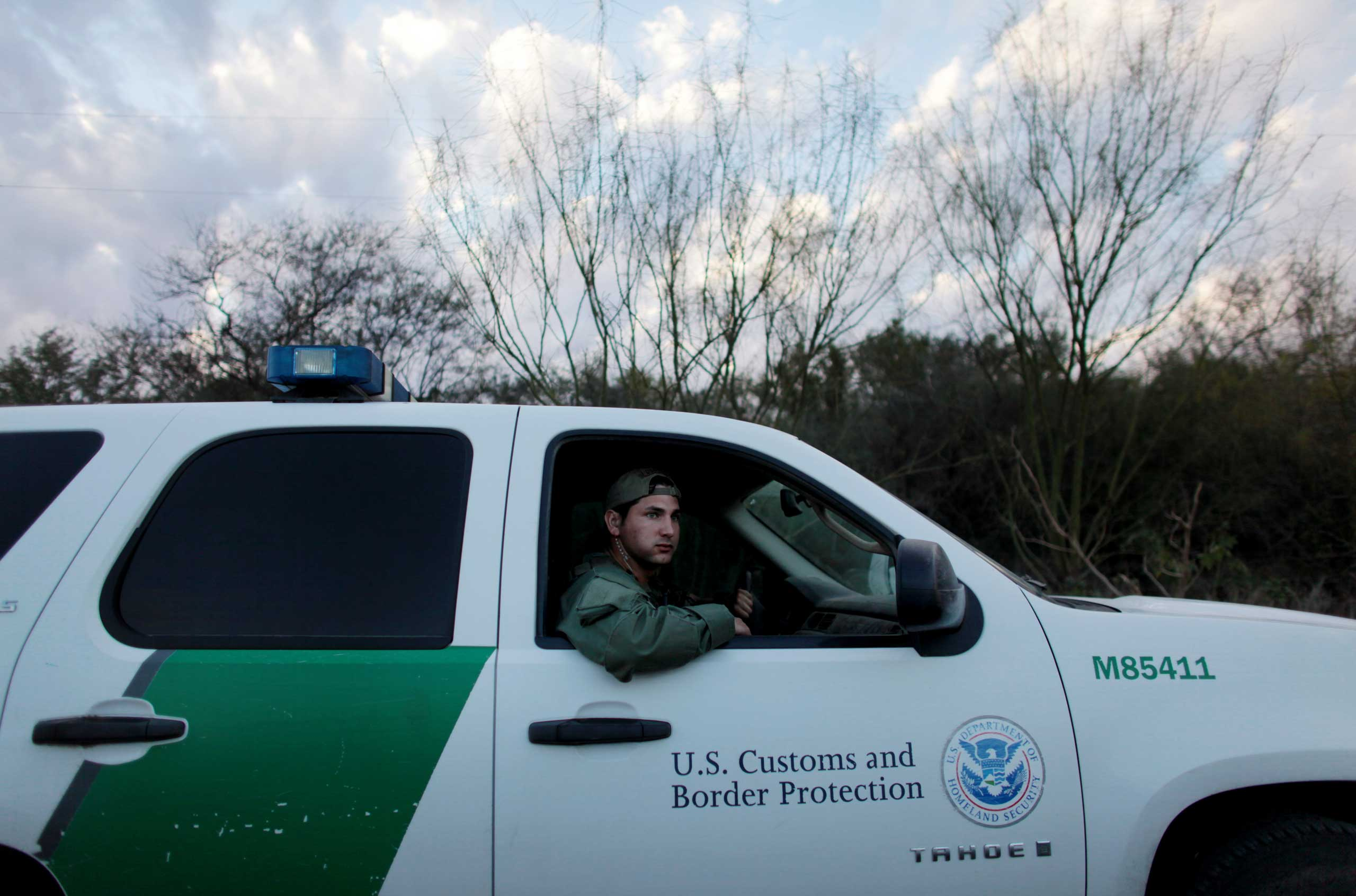 Border Patrol agents patrol the floodplain along the banks of the Rio Grande, south of Mission, Texas on Feb. 13, 2013.