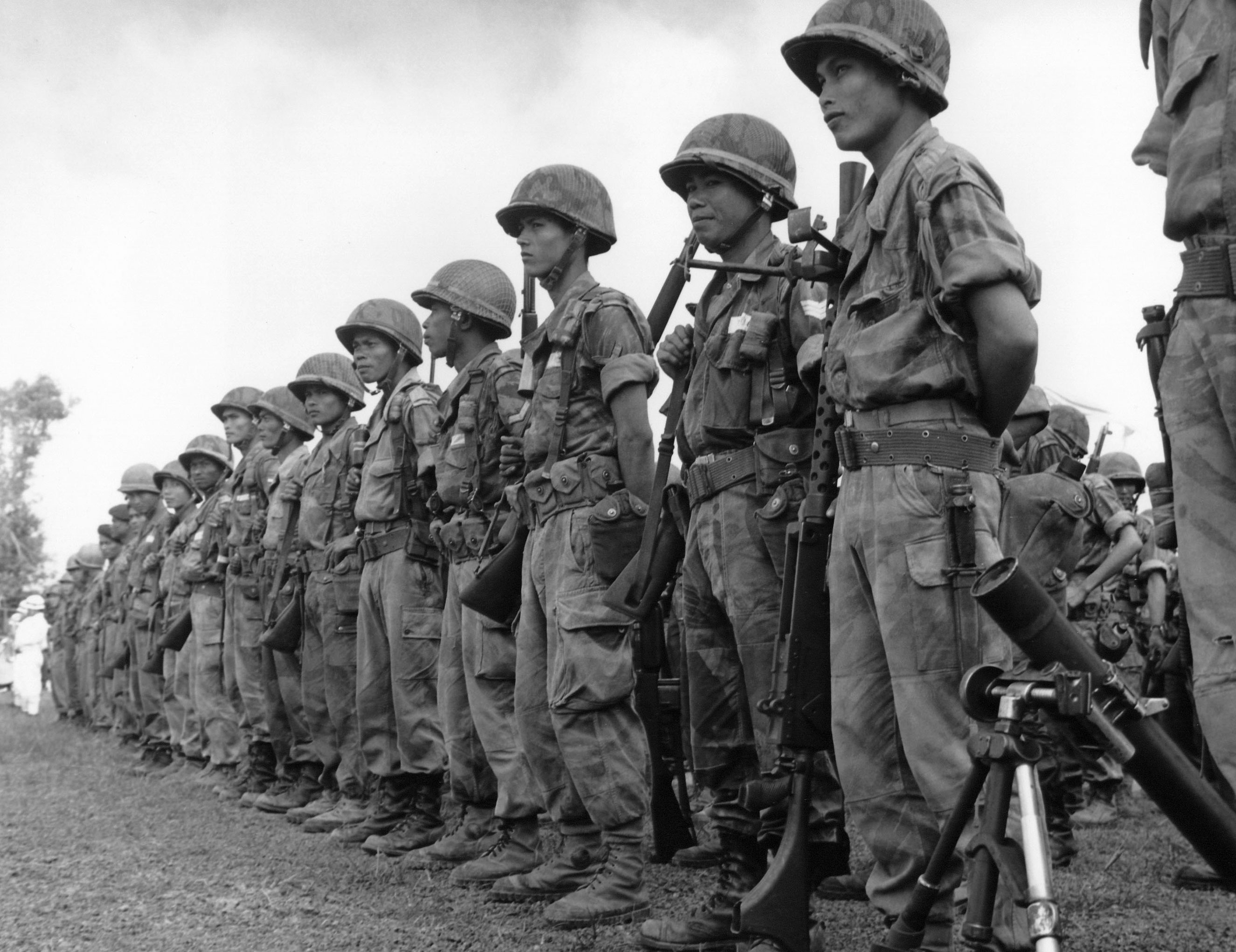 South Vietnamese government troops at Moc Hoa village some 60 miles Southwest of Saigon after a second major victory over Viet Cong rebels on Aug. 24, 1961.