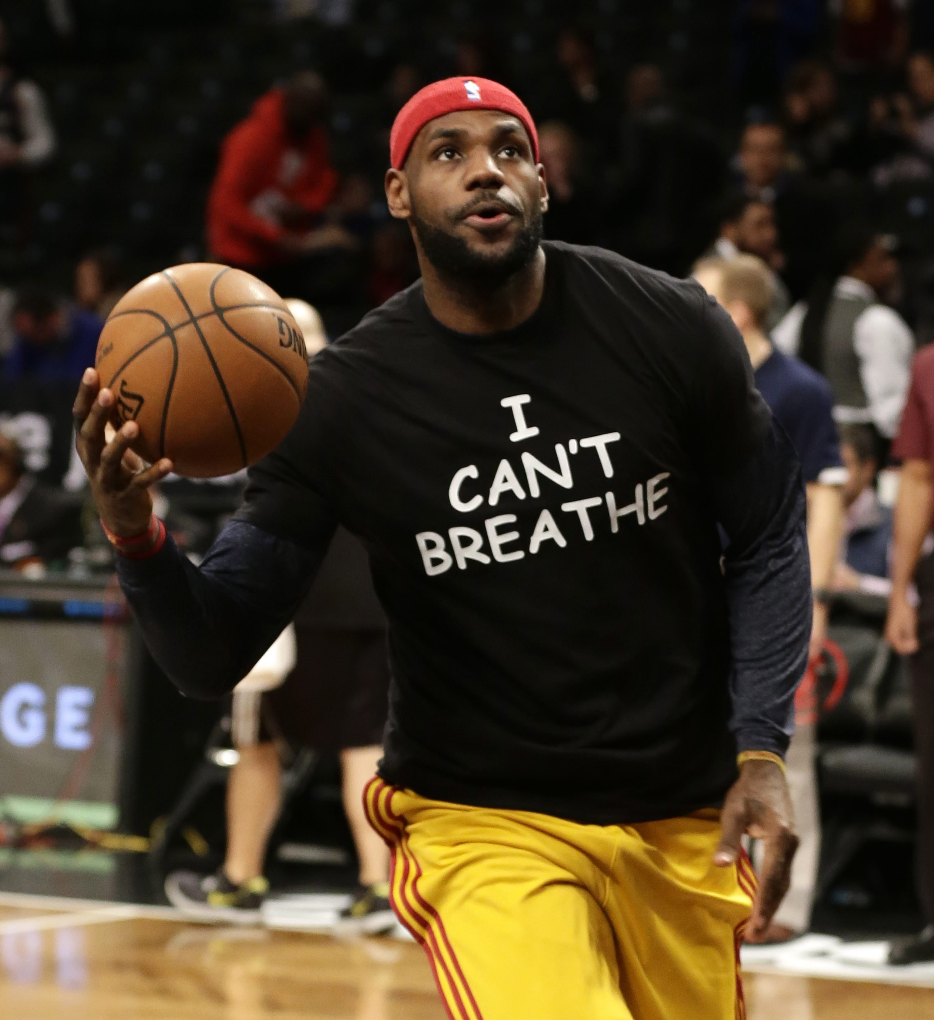 Cleveland Cavaliers forward LeBron James warms up before an NBA basketball game against the Brooklyn Nets at the Barclays Center on Dec. 8, 2014, in New York.
