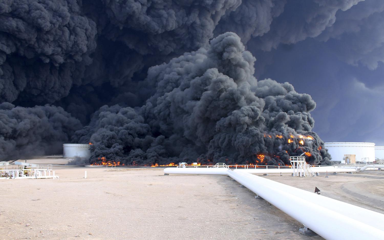 Smoke rises from an oil-tank fire in the Sidra port in Libya on Dec. 26, 2014