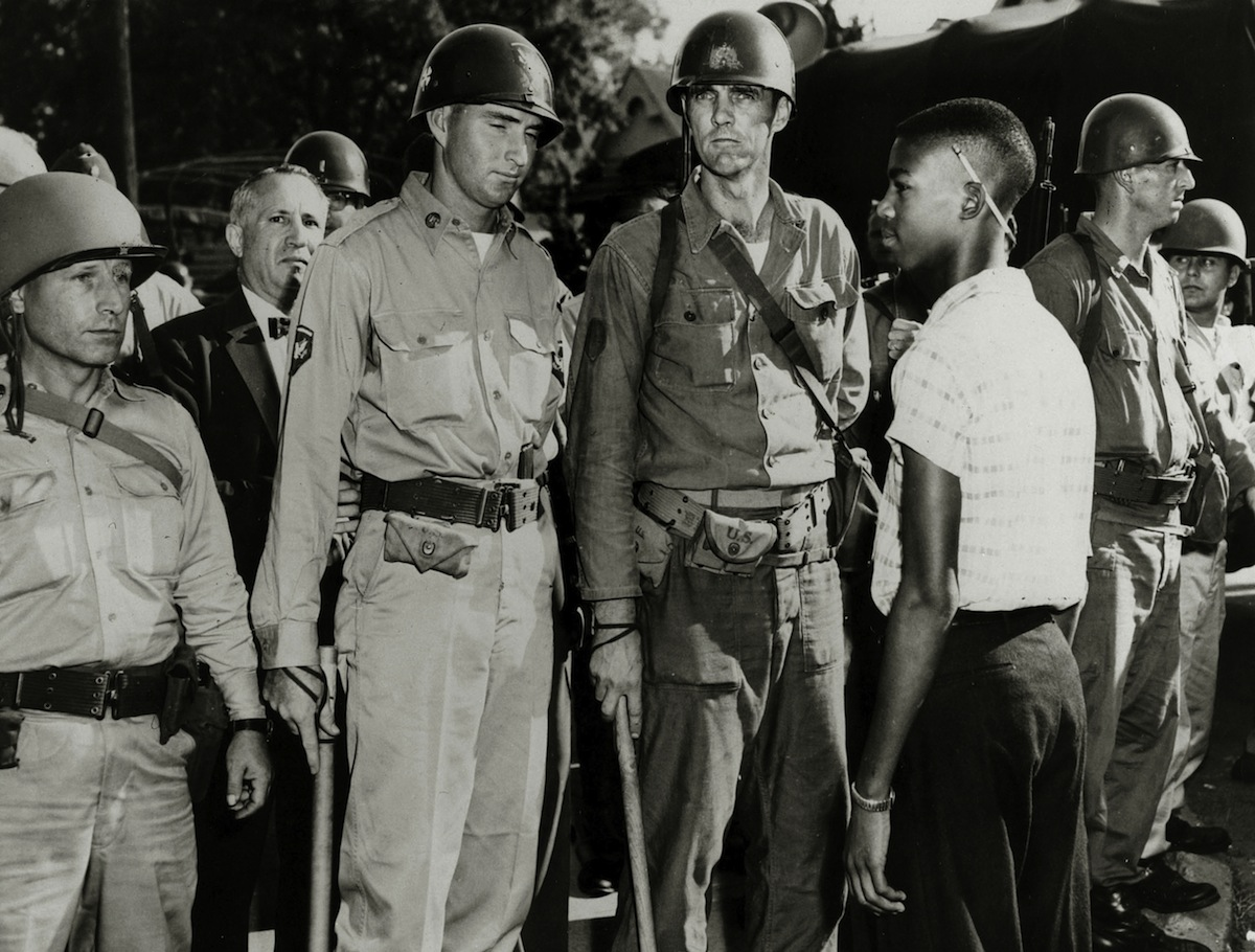 Little Rock, Ark., 1957: National Guardsmen, having admitted white children to a school, bar the way to a black student