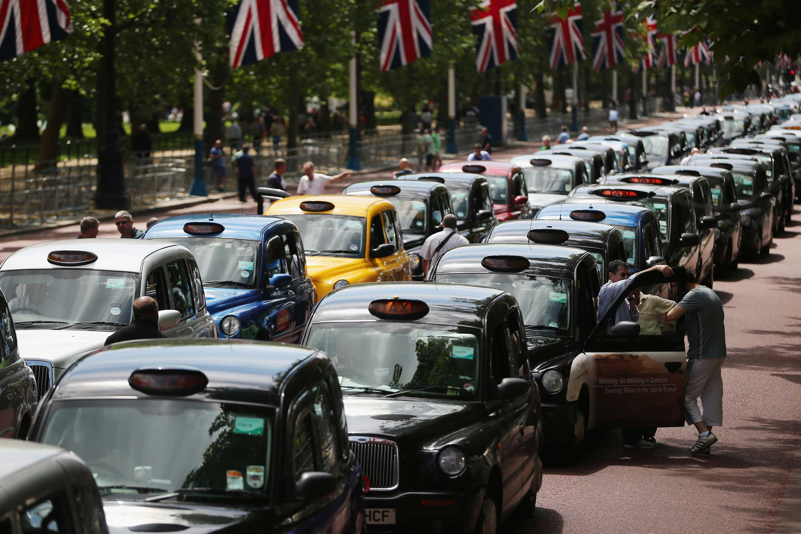 London taxi's line up on The Mall during a protest against a new smart phone app, 'Uber' on June 11, 2014 in London.
